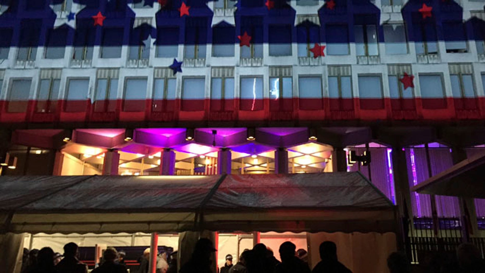 People queue outside for an Election Night Party at The United States Embassy, in London, Tuesday, Nov. 8, 2016. The US headed for the polls to vote for their new president. (AP Photo/Frank Augstein)