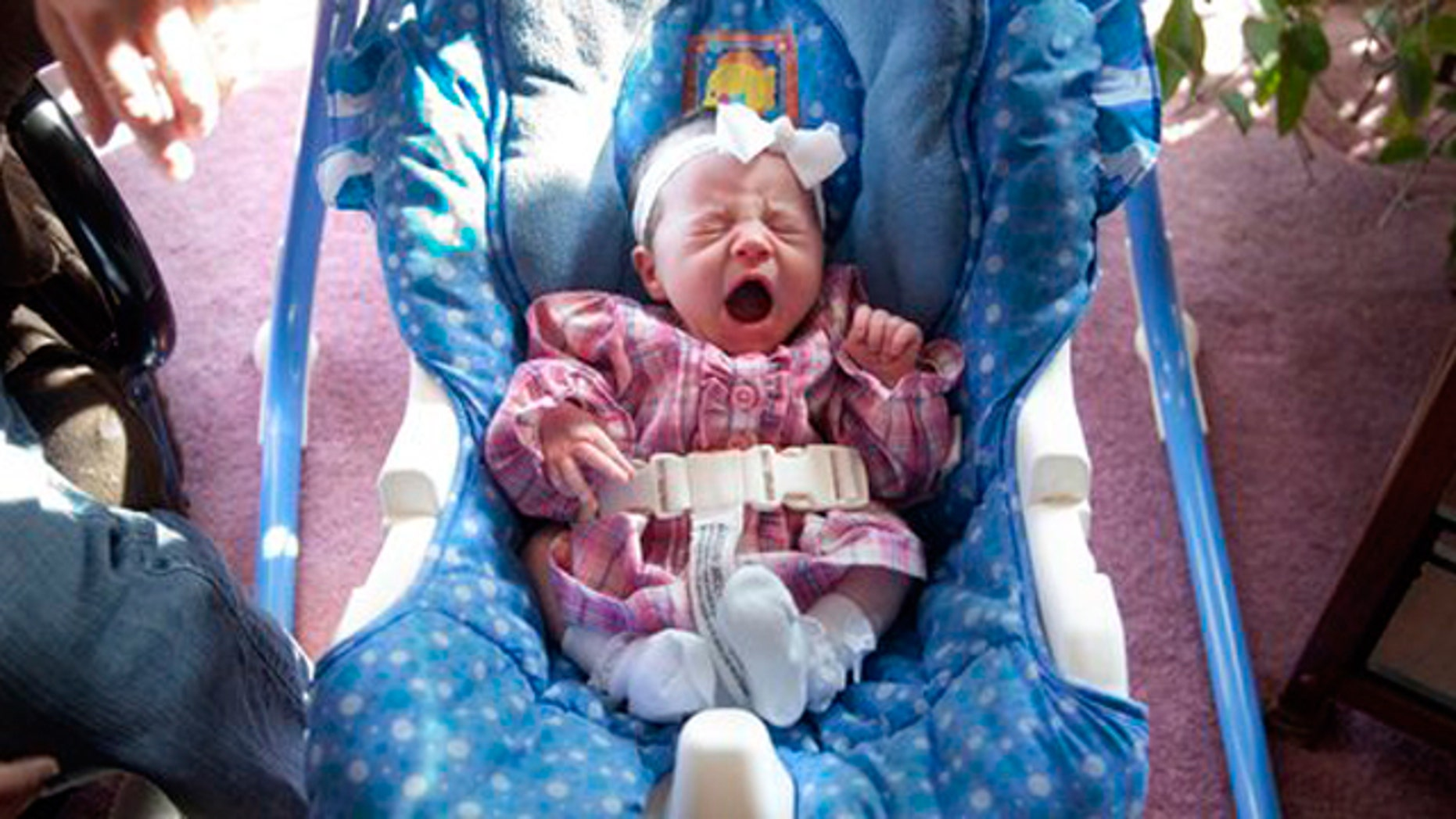 Alyssa Lynn Leming gives a big yawn in her rocker on Monday, Feb. 21, 2011 in her Lecompton, Kan. home. Alyssa was born in a hospital elevator.