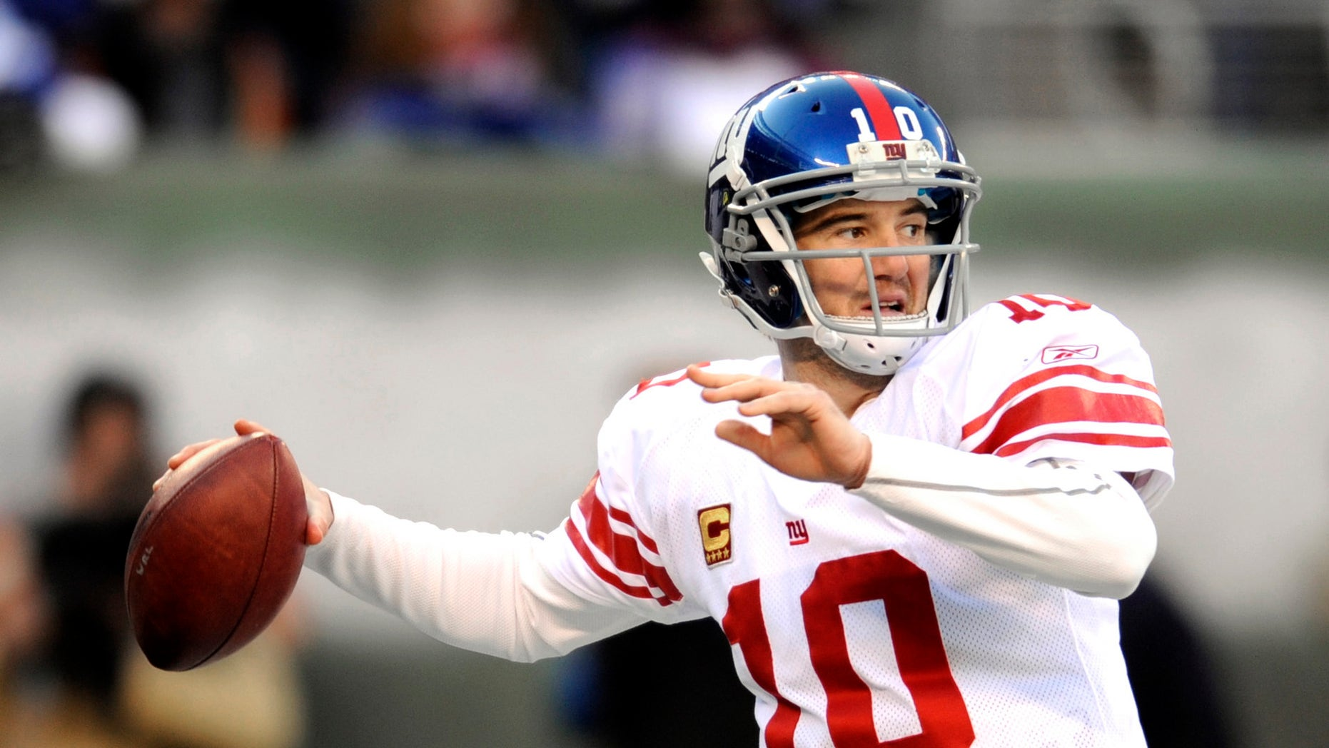 In this Dec. 24, 2011, file photo, New York Giants quarterback Eli Manning looks to pass during the second quarter of an NFL football game against the New York Jets, in East Rutherford, N.J.