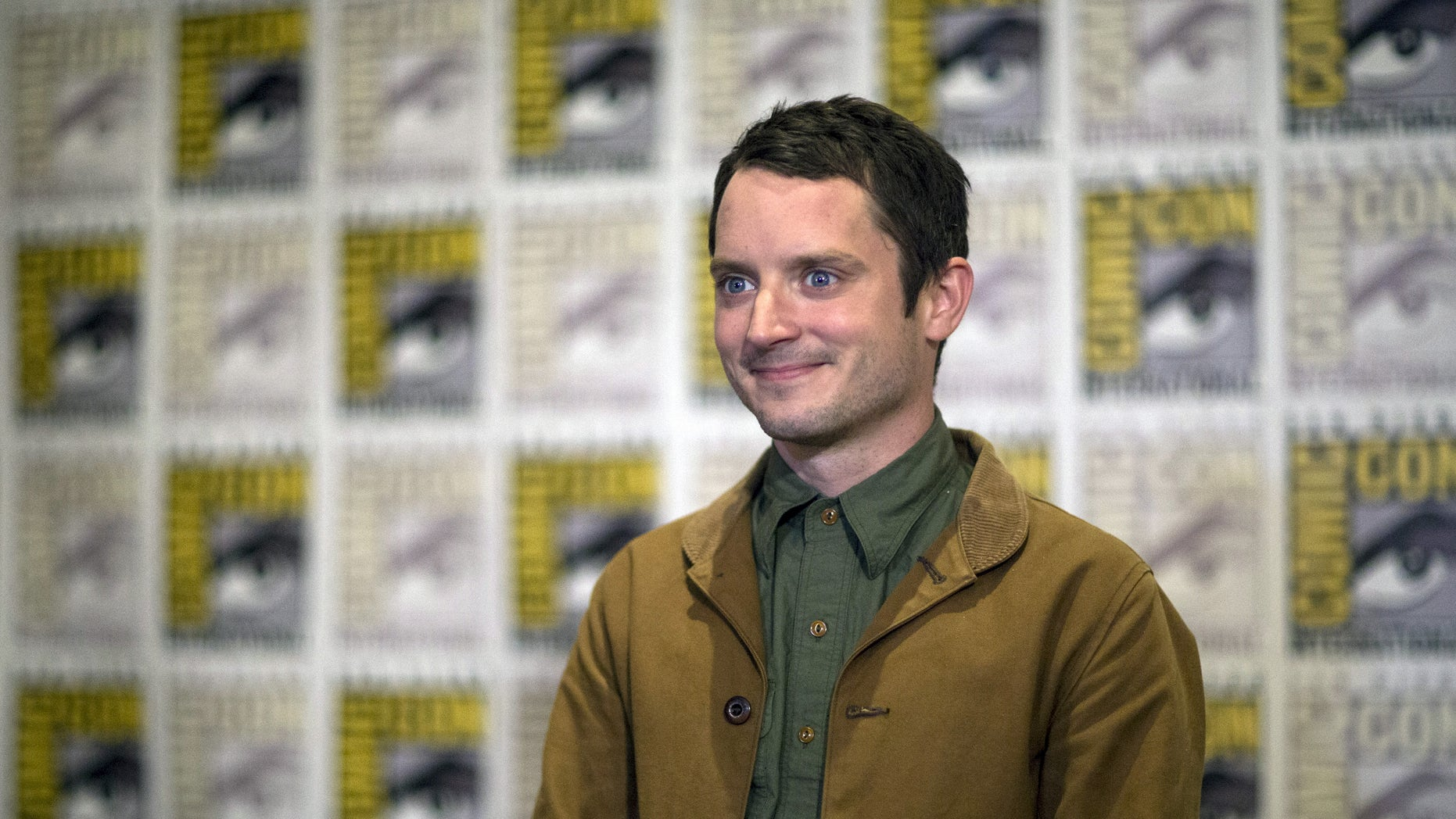 """Actor Elijah Wood poses at a press line for """"The Hunger Games: Mockingjay - Part 2"""" during the 2015 Comic-Con International Convention in San Diego, California July 9, 2015. REUTERS/Mario Anzuoni - RTX1JSRV"""