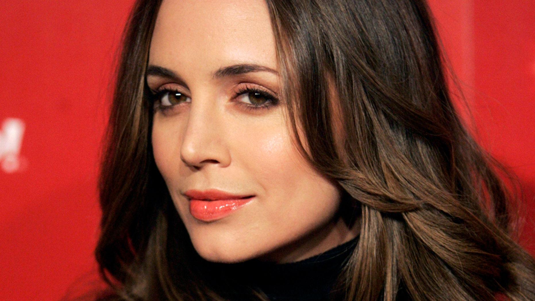 Eliza Dushku poses at the US Weekly Fall Hot Hollywood Issue party in West Hollywood, California November 18, 2009. The actress recently opened up about battling drug and alcohol addiction.