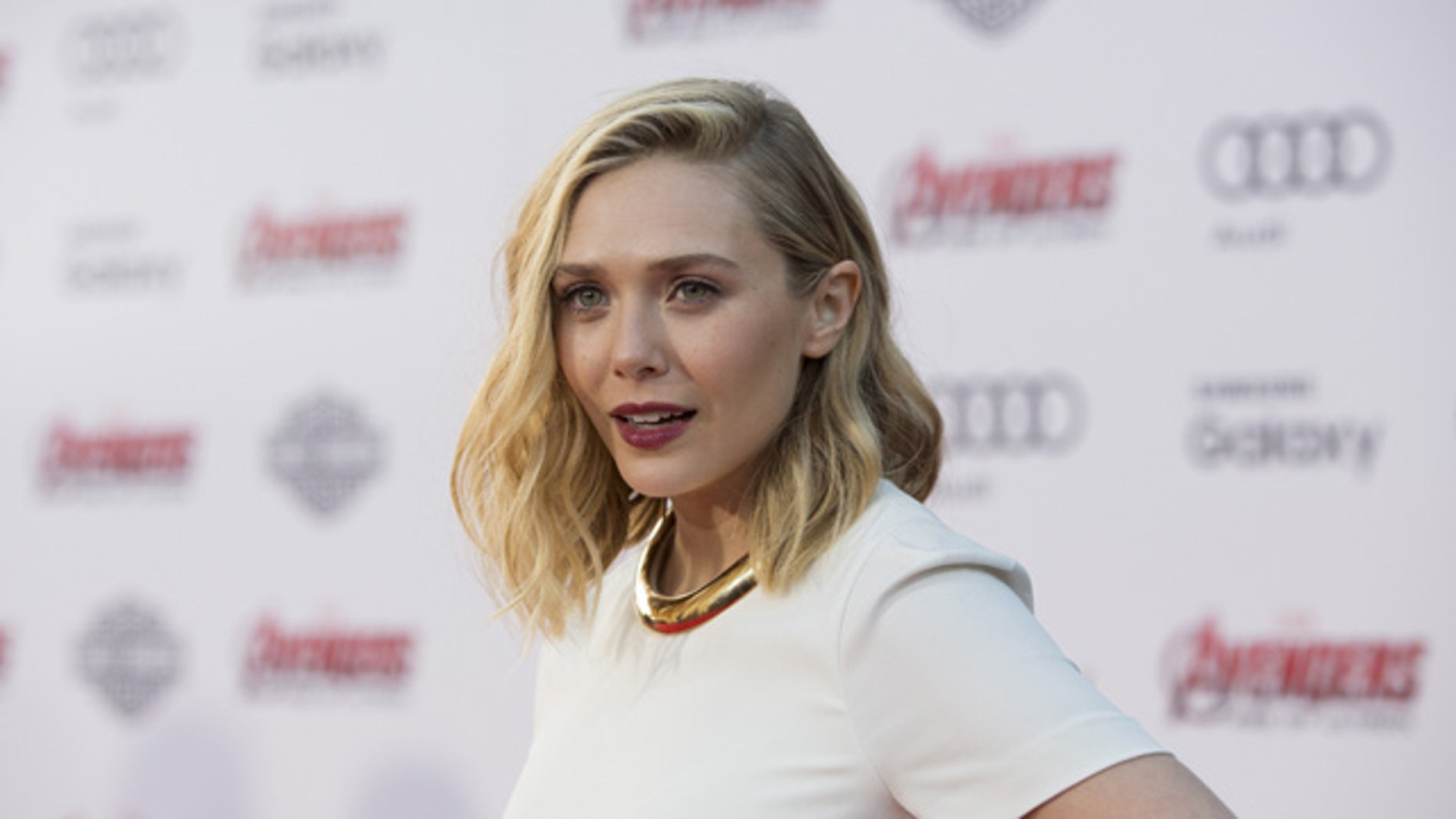 """April 13, 2015. Cast member Elizabeth Olsen poses at the premiere of """"Avengers: Age of Ultron"""" at Dolby theatre in Hollywood, California."""