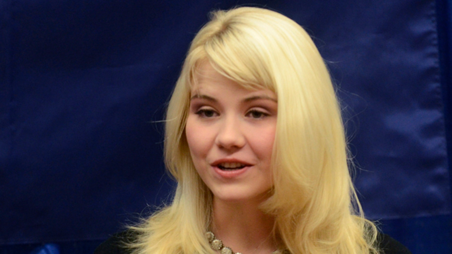 Oct. 30, 2012: In this file photo, Elizabeth Smart speaks to reporters regarding her advocacy of child protection and the healing process she has experienced, prior to her presentation at the Child Sexual Abuse Conference, in State College, Pa.