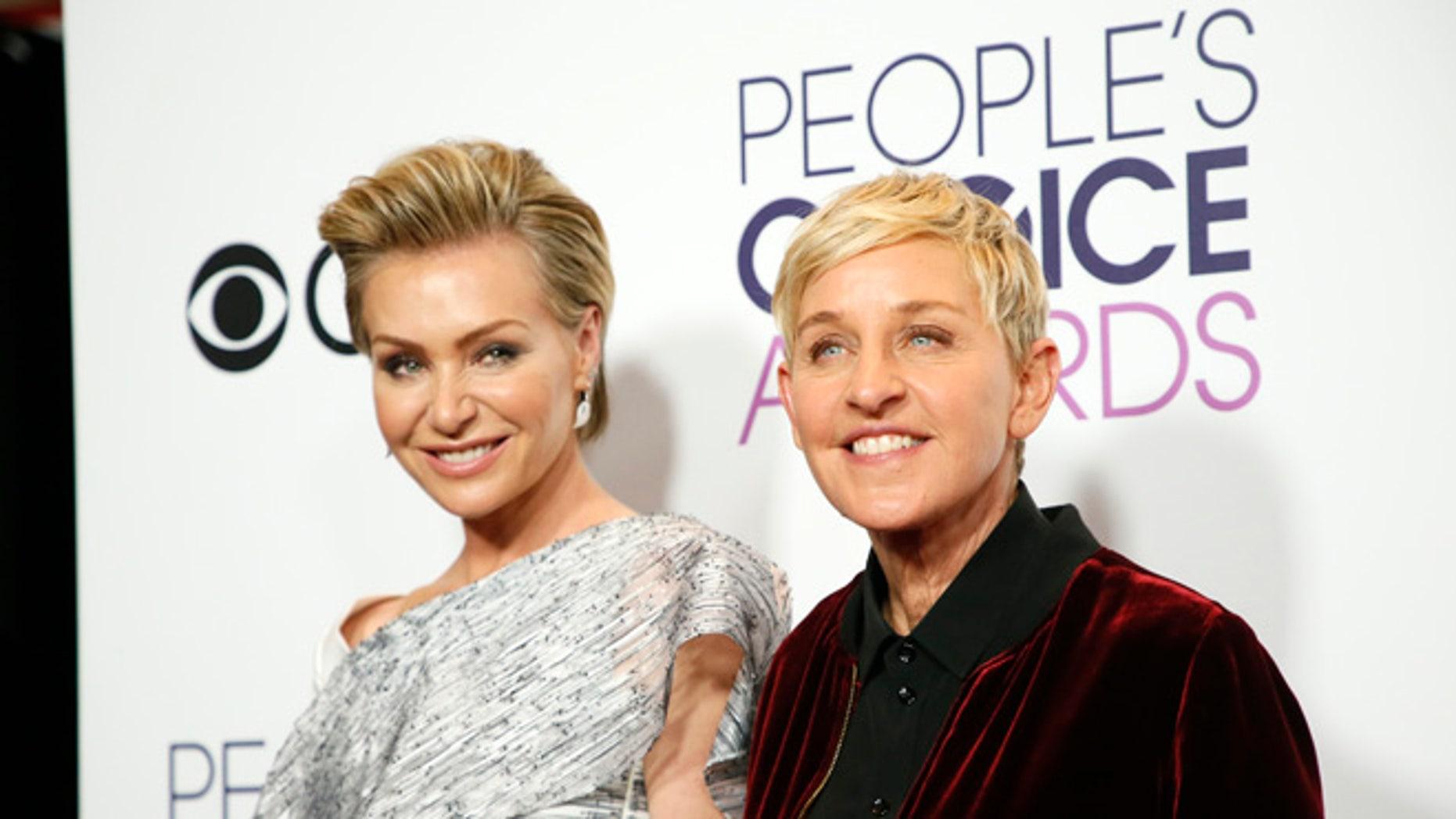 Ellen DeGeneres with wife Portia de Rossi wishes she had come out sooner