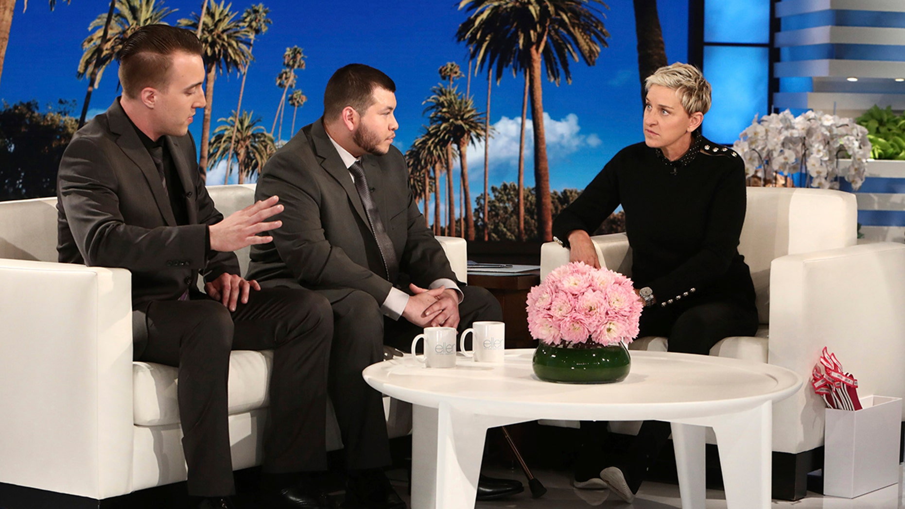 Las Vegas hotel employees Stephen Schuck, left, and Jesus Campos talk with TV host Ellen DeGeneres during a show taped earlier this month.