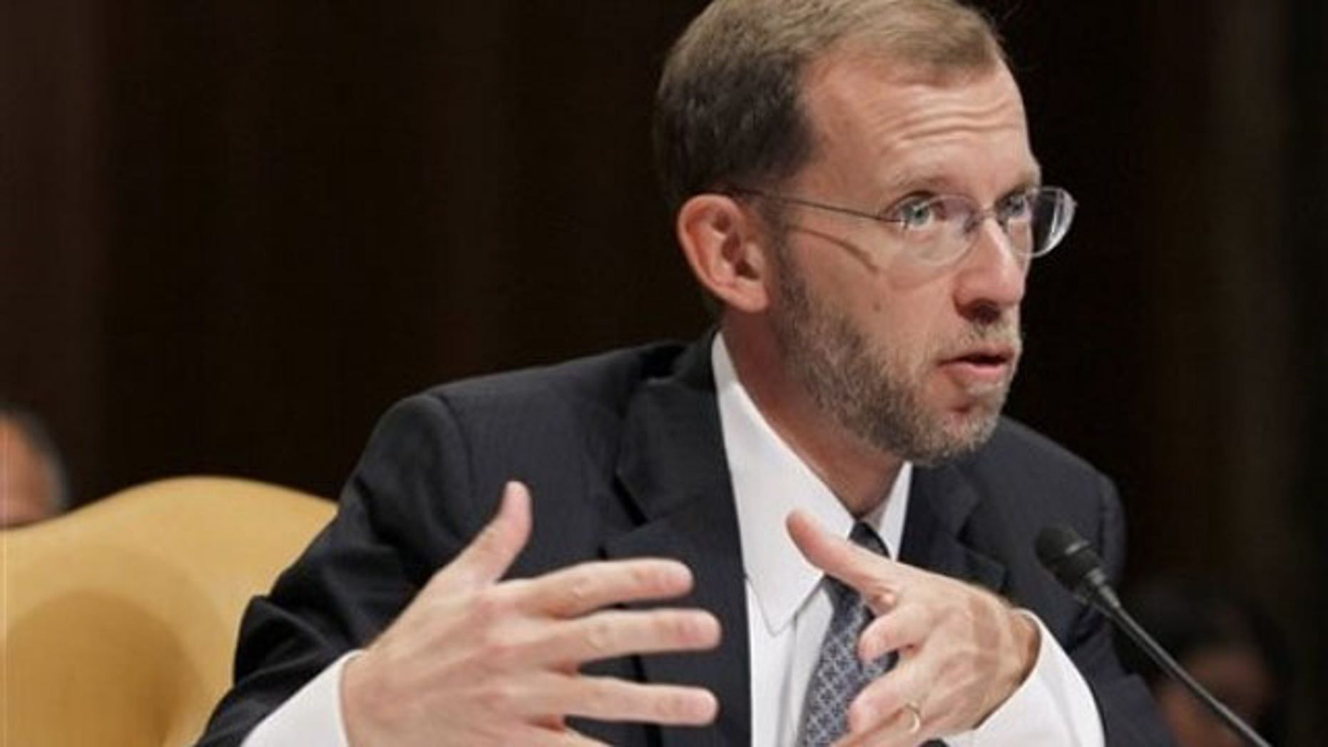 FILE: In this Sept. 28, 2010, photo, Congressional Budget Office Director Douglas Elmendorf testifies on Capitol Hill.