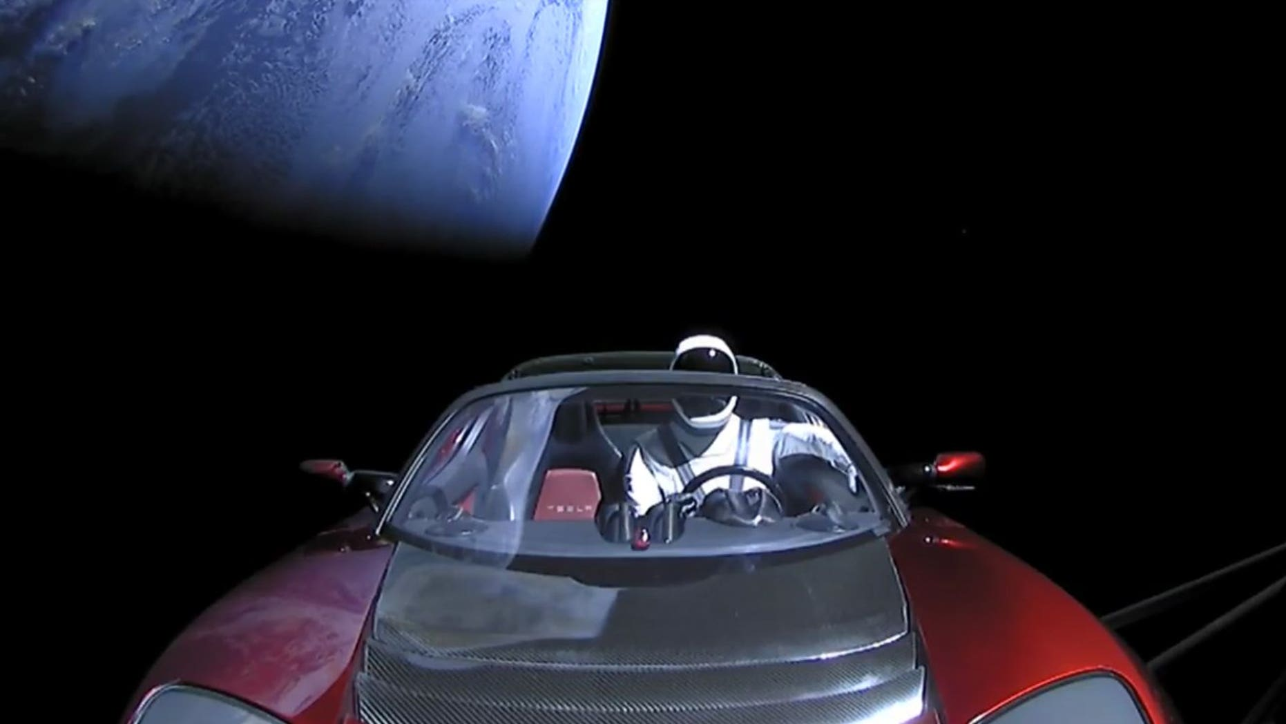 Starman and his Tesla leave Earth behind shortly after launching atop SpaceX's Falcon Heavy rocket on Feb. 6, 2018.