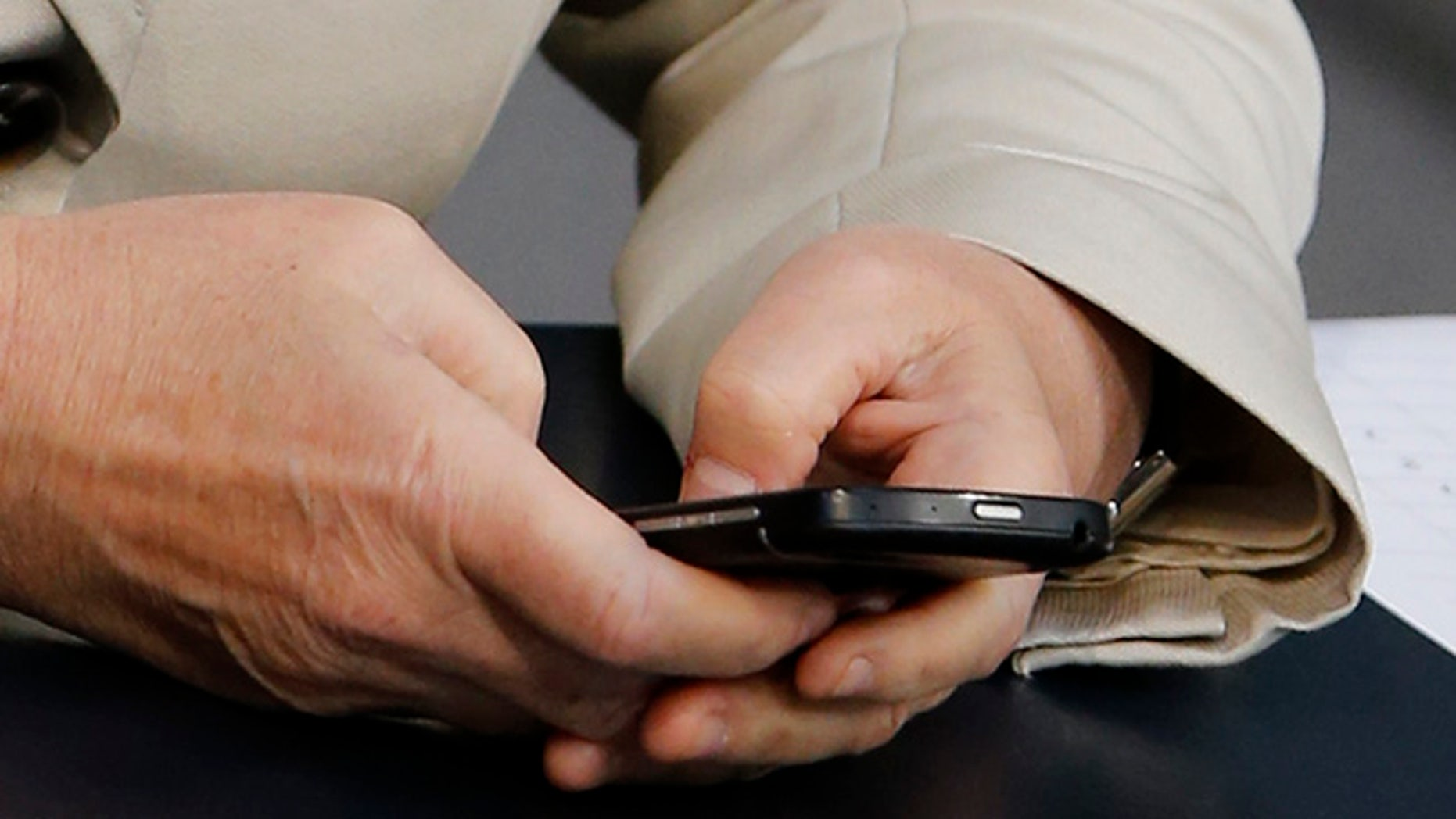FILE: UNDATED: A person sends an email on a smartphone.