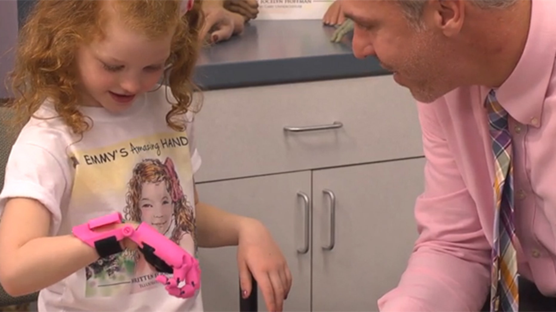 Emmy Hoffman, 5, was fitted with 3-D printed fingers.