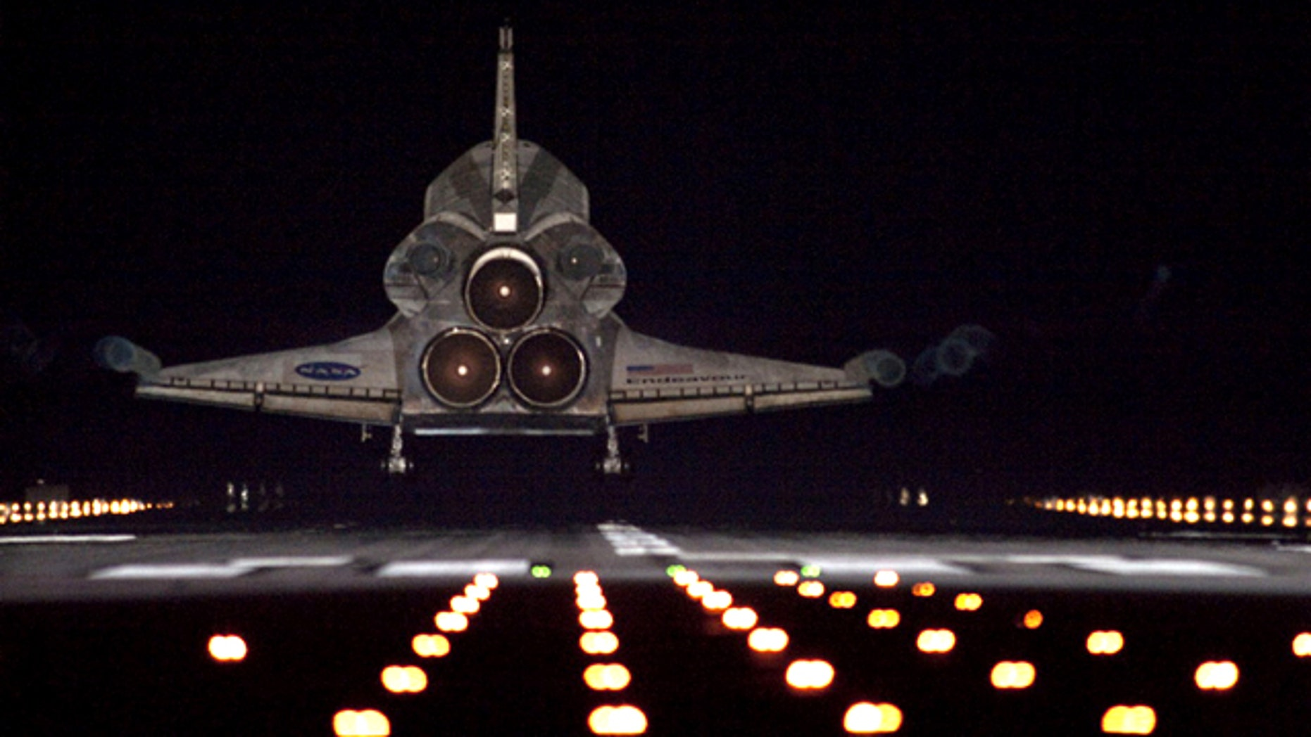 Runway lights help lead space shuttle Endeavour, seen here from behind, home to NASA's Kennedy Space Center in Florida. Endeavour landed for the final time on the Shuttle Landing Facility's Runway 15, on June 1, 2011, marking the 24th night landing of NASA's Space Shuttle Program.