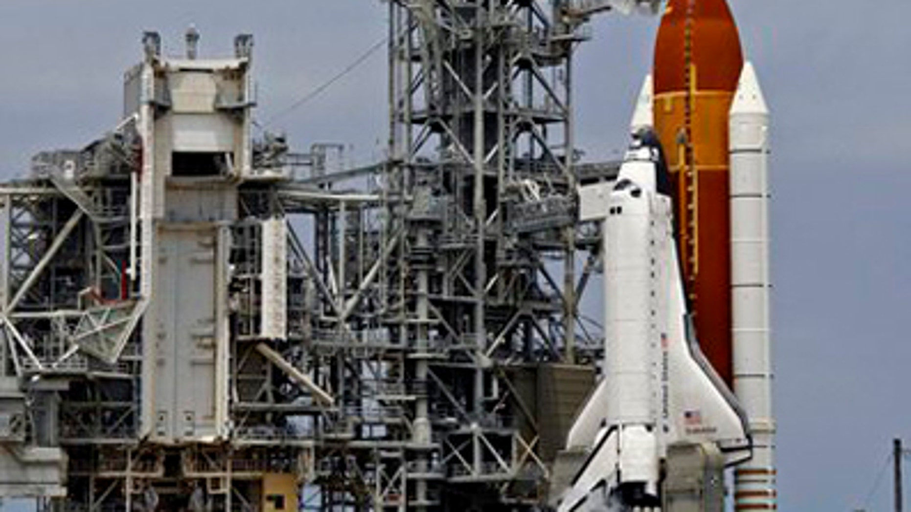 In this April 29, 2011 file photo, space shuttle Endeavour is seen on Pad 39A moments after launch was scrubbed because of technical problems at the Kennedy Space Center in Cape Canaveral, Fla. NASA will try again next Monday, May 16. 2011 to launch Endeavour on the next-to-last space shuttle flight, after replacing a switch box and plugging in new electrical wiring. (AP/File)