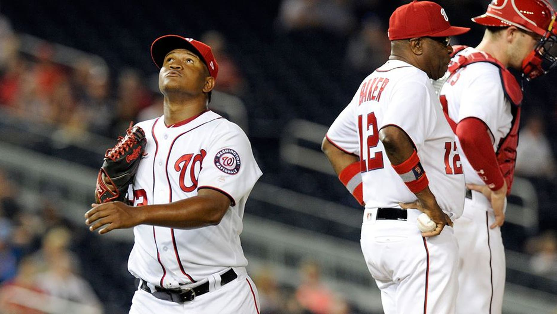 WASHINGTON, DC - JUNE 12: Enny Romero #72 of the Washington Nationals walks to the dugout after being removed from the game in the eighth inning against the Atlanta Braves at Nationals Park on June 12, 2017 in Washington, DC. Atlanta won the game 11-10. (Photo by Greg Fiume/Getty Images)