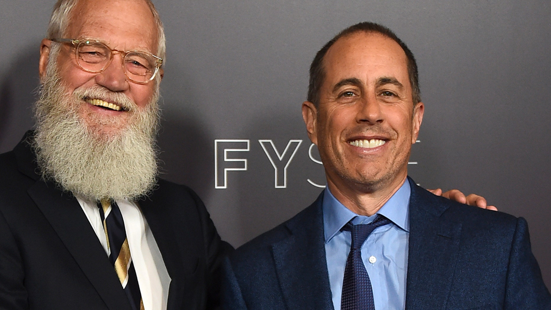 "David Letterman, left, and Jerry Seinfeld arrive at the ""My Next Guest Needs No Introduction with David Letterman"" FYC event."