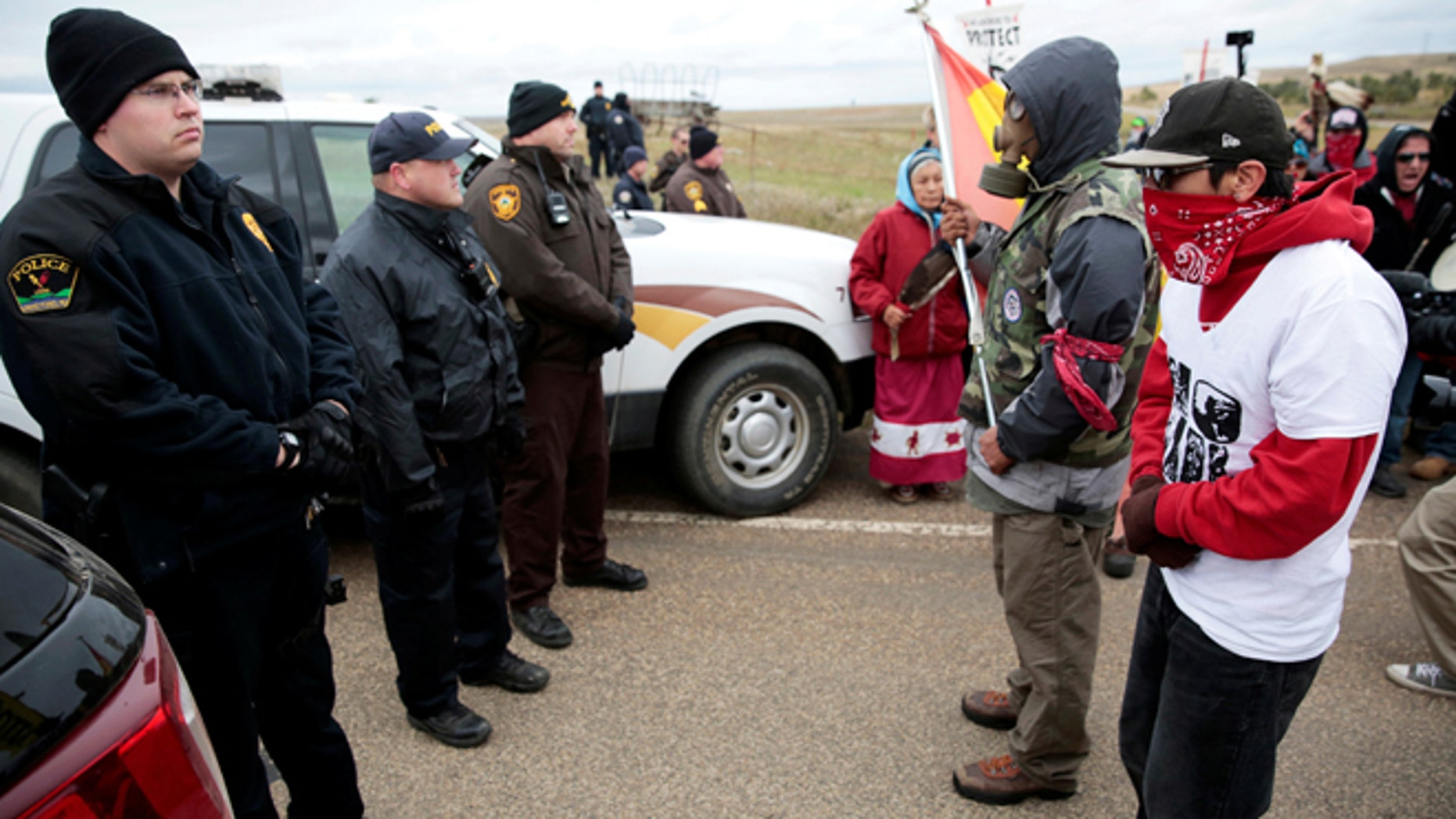 Oct. 5: Dakota Access Pipeline protesters square off against police between the Standing Rock Reservation and the pipeline route outside the little town of Saint Anthony, North Dakota,