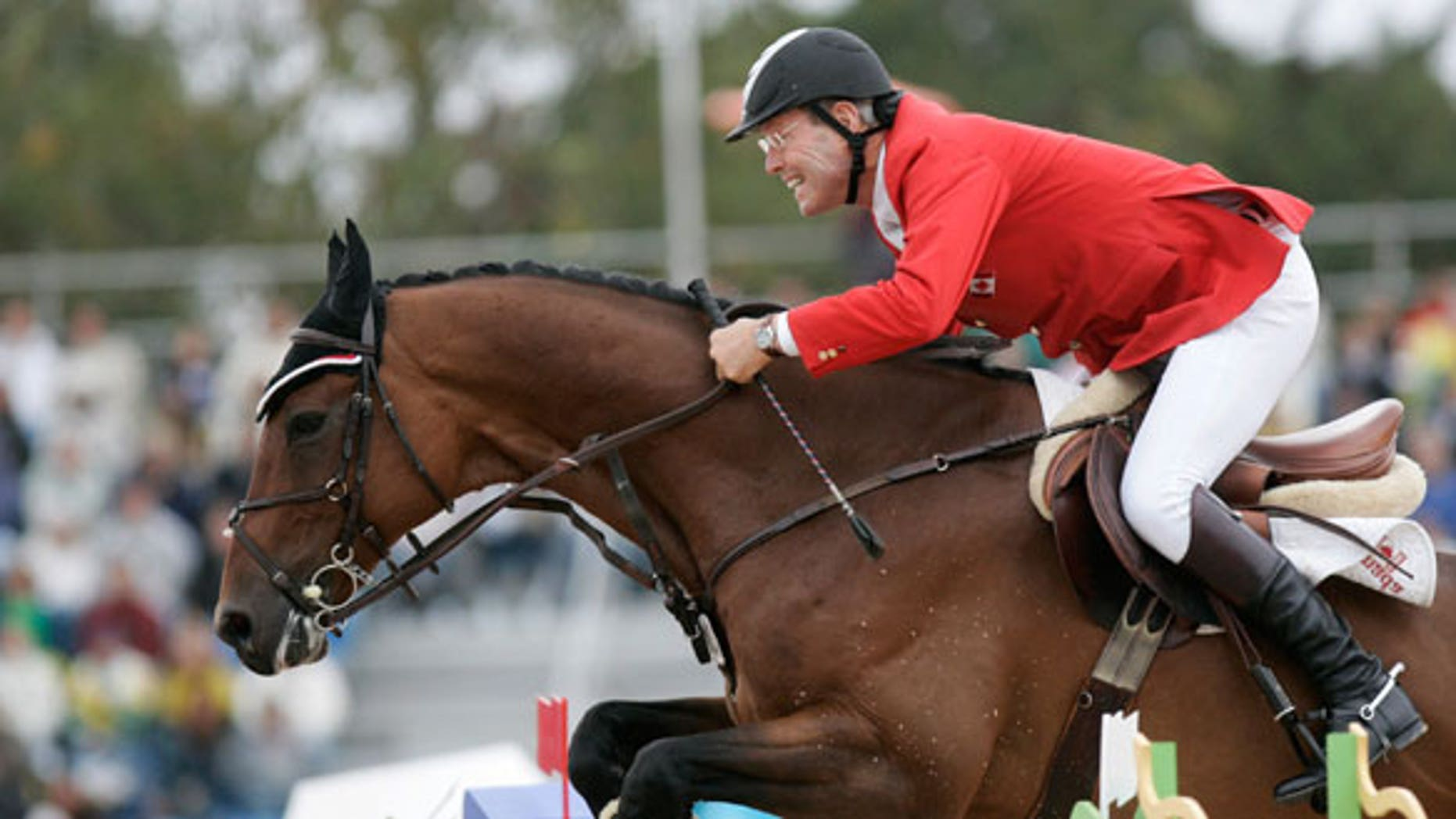 """July 29, 2007: Canada's Ian Millar rides """"In Style"""" during the final jumping competition at the Pan American Games in Rio de Janeiro."""
