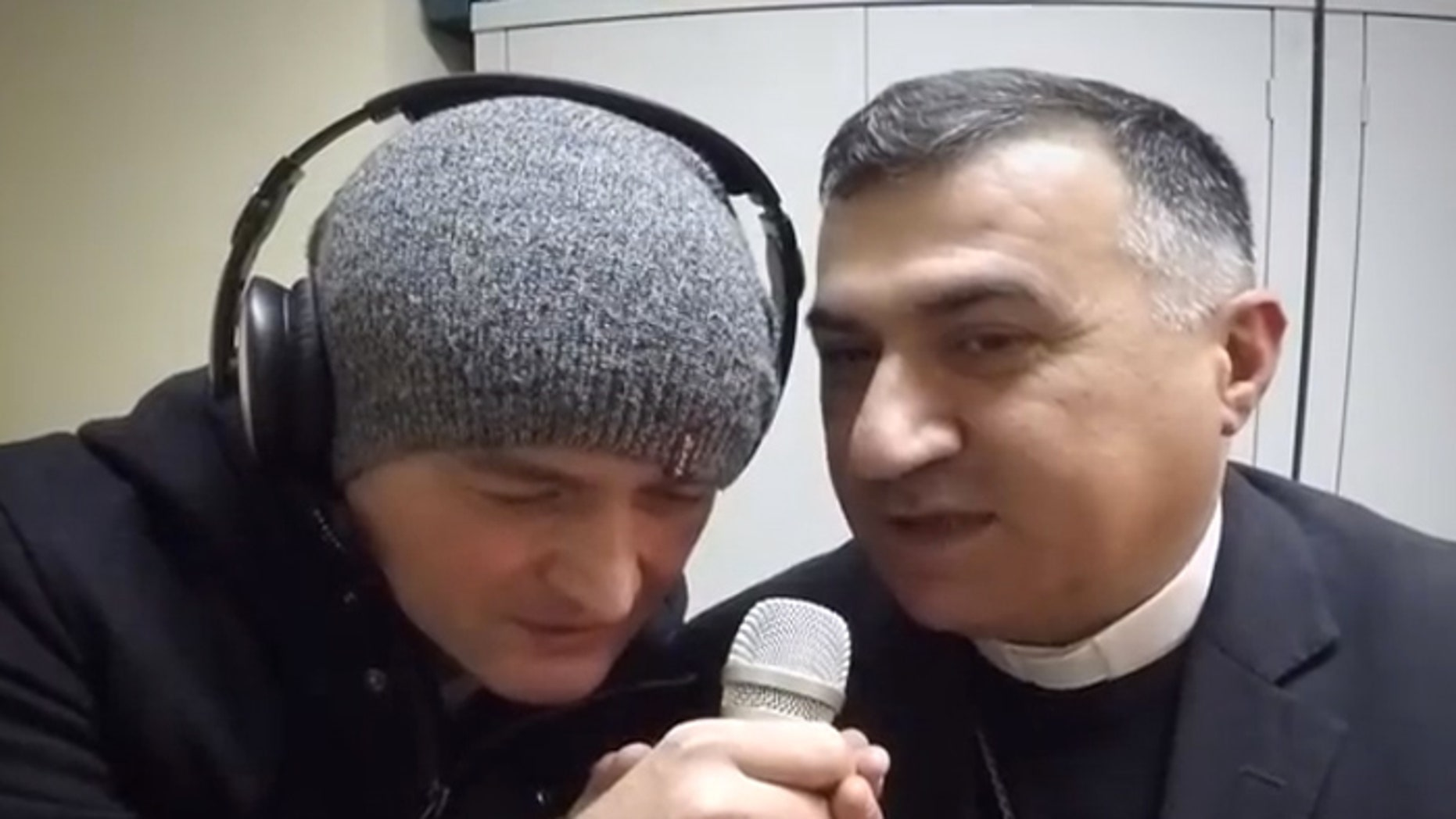 Hal St John of Ooberfuse and Archbishop Warda in the We Are One video . (Screengrab)