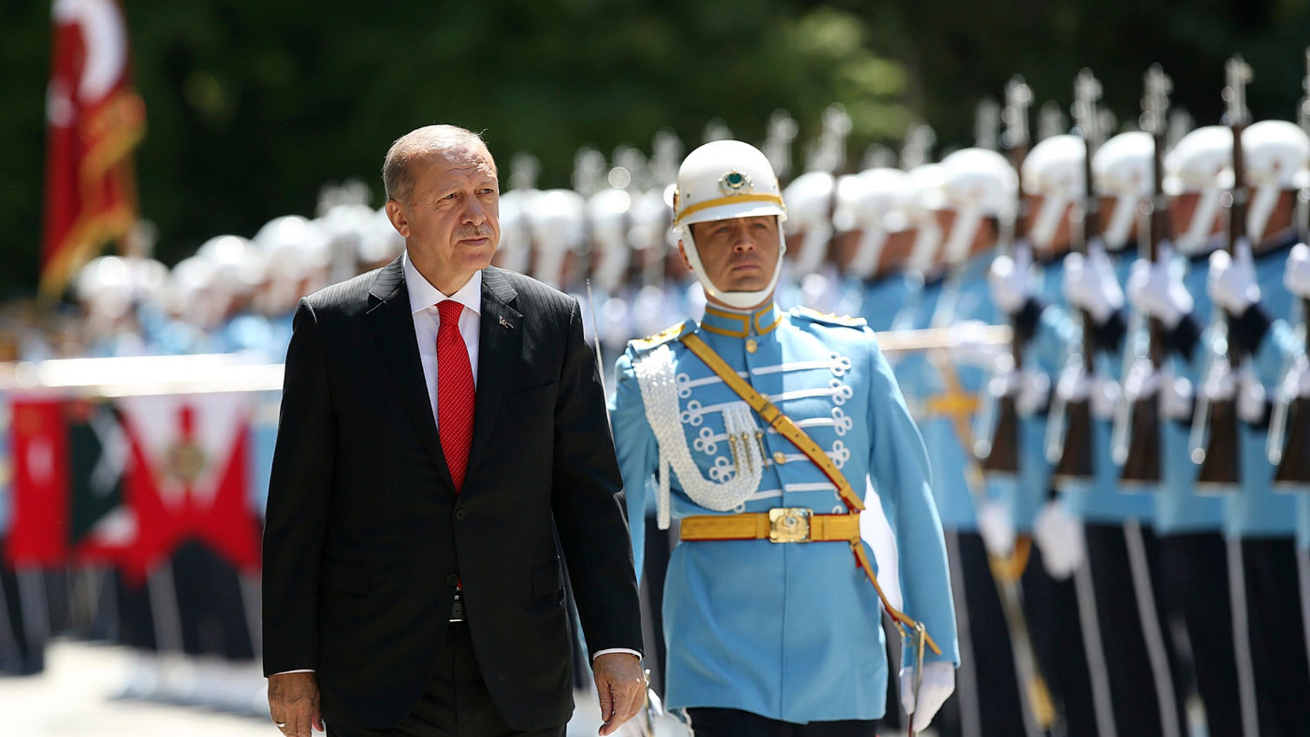 Turkey's President Recep Tayyip Erdogan inspects an honour guard as he arrives at the parliament in Ankara, Turkey to attend opening session of the new parliament in Ankara, Turkey, Saturday, July 7, 2018.