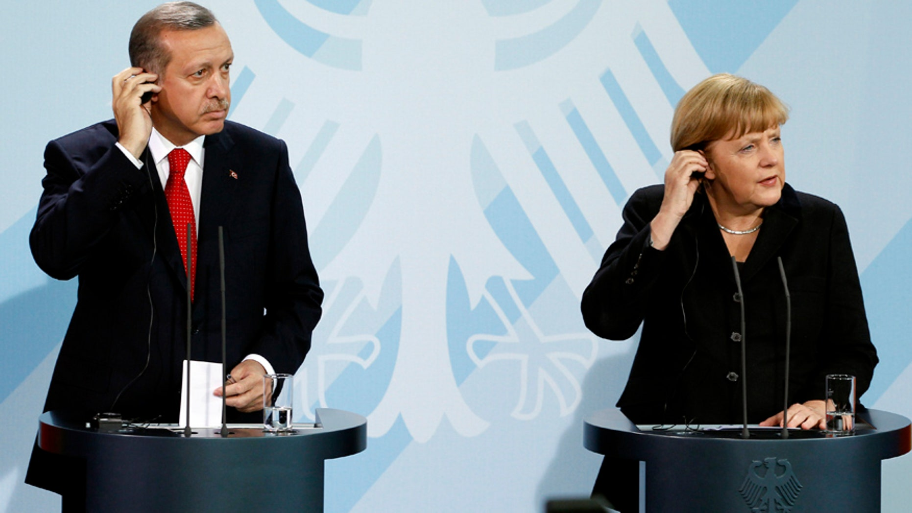 Oct. 31, 2012: German Chancellor Angela Merkel, right, and Turkey's  President Recep Tayyip Erdogan, left, address the media during a joint press conference after a meeting at the chancellery in Berlin, Germany.