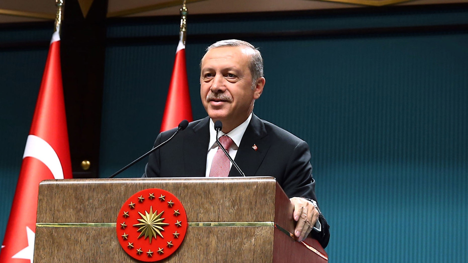 Turkey's President Recep Tayyip Erdogan speaks after an emergency meeting of the government in Ankara, Turkey, late Wednesday, July 20, 2016. (Kayhan Ozer/Pool Photo via AP)