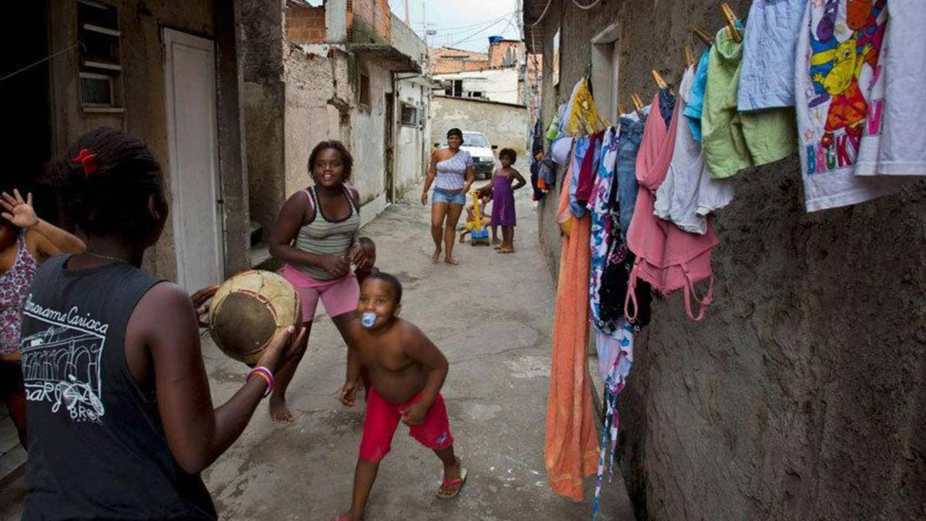 Children play in Favela do Metro shantytown in Rio de Janeiro, Brazil.