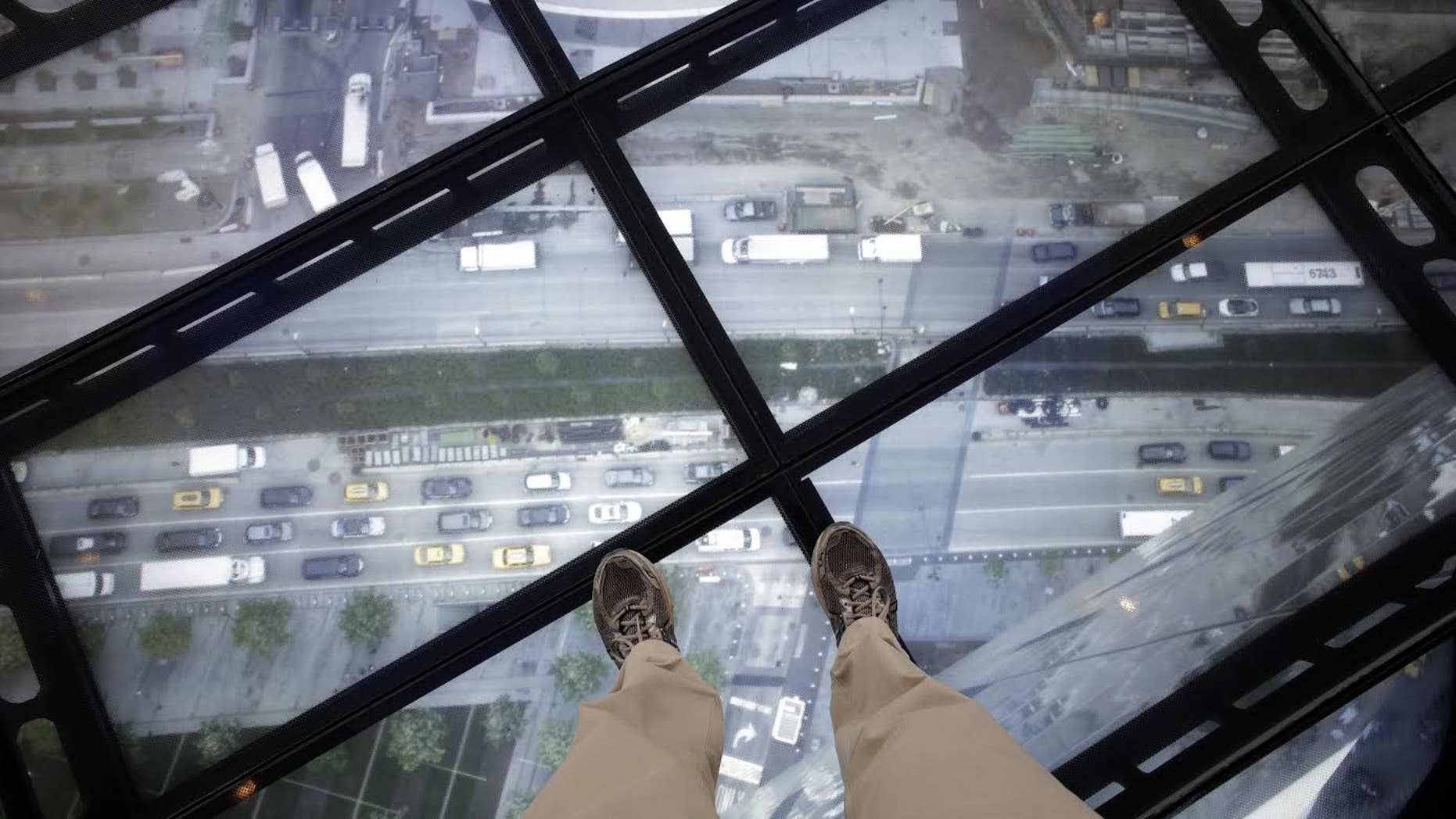 A view through the Sky Portal shows a live video view of the streets below from One World Observatory, Wednesday, May 20, 2015, in New York. The observatory atop the 104-story One World Trade Center opens to the public on May 29. (AP Photo/Mark Lennihan)