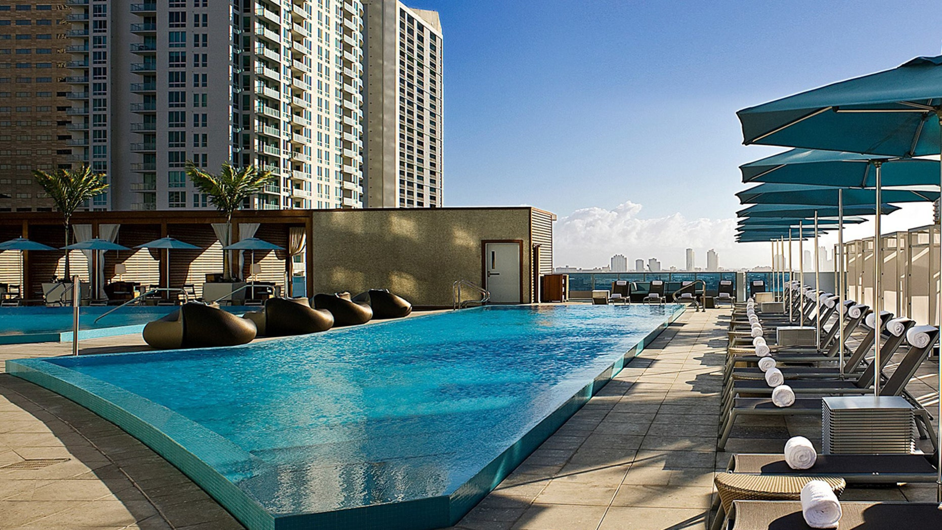 The pool deck at the EPIC hotel, a Kimpton property, in Miami. The boutique hotel chain operates 62 hotels across the country.