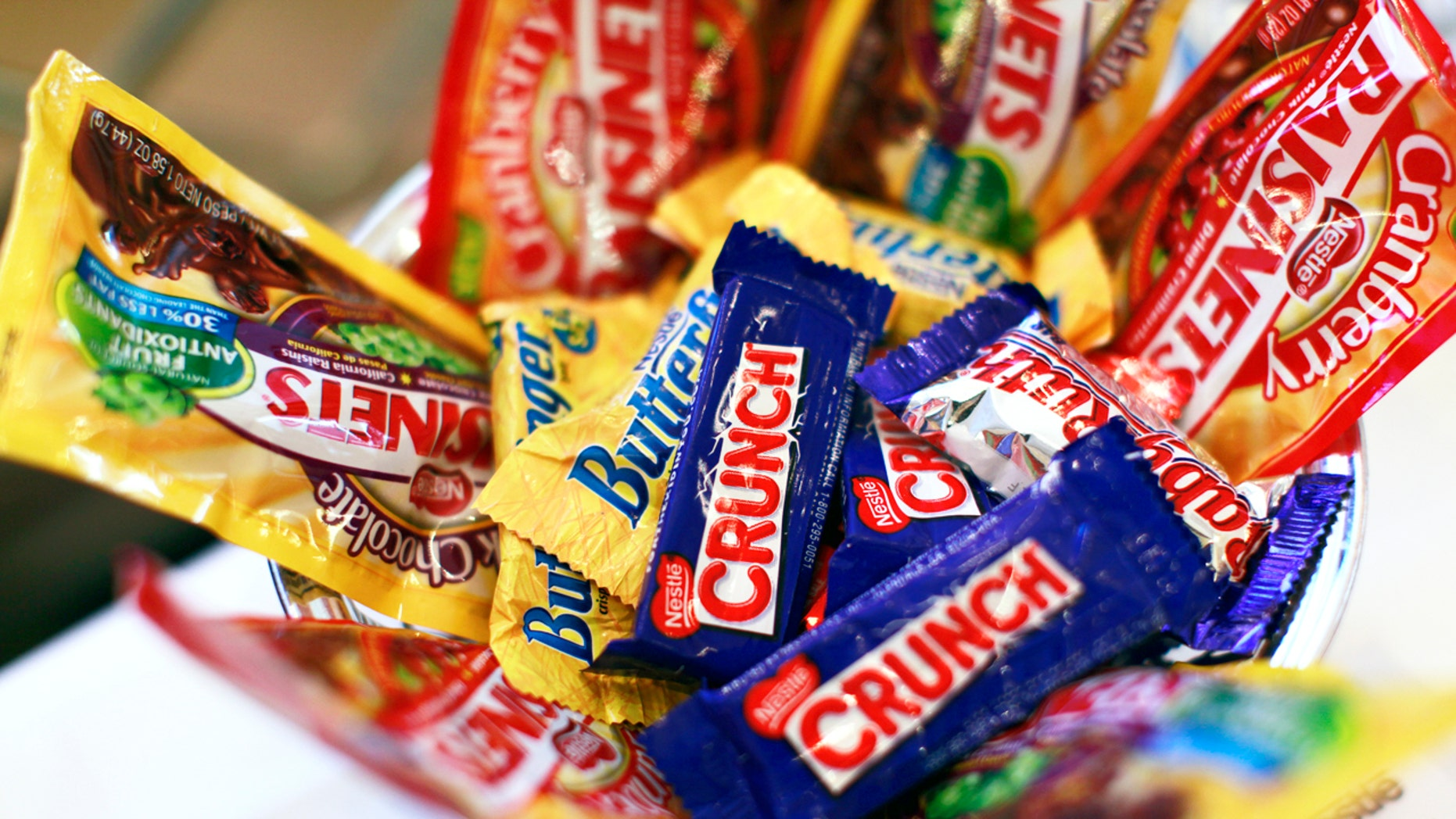 Nestle says its new candy will be just as sweet-- with much less sugar.