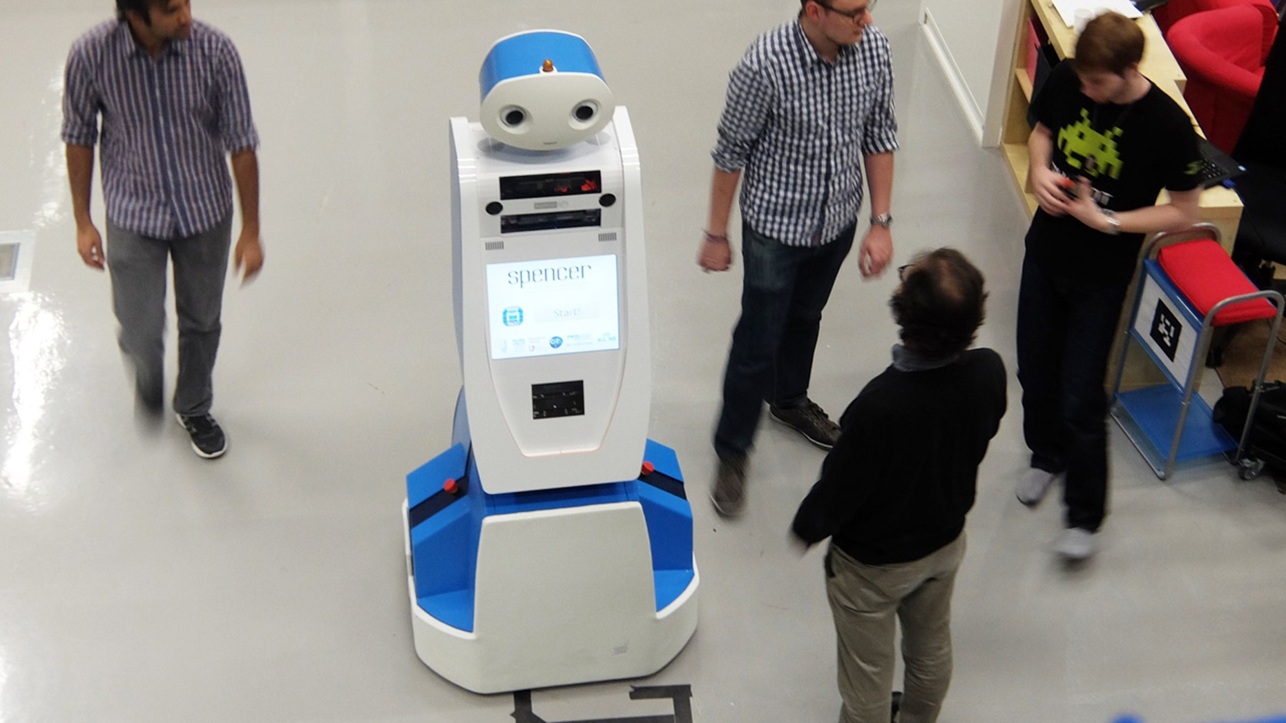 Spencer the robot helps airline passengers navigate through busy terminals.