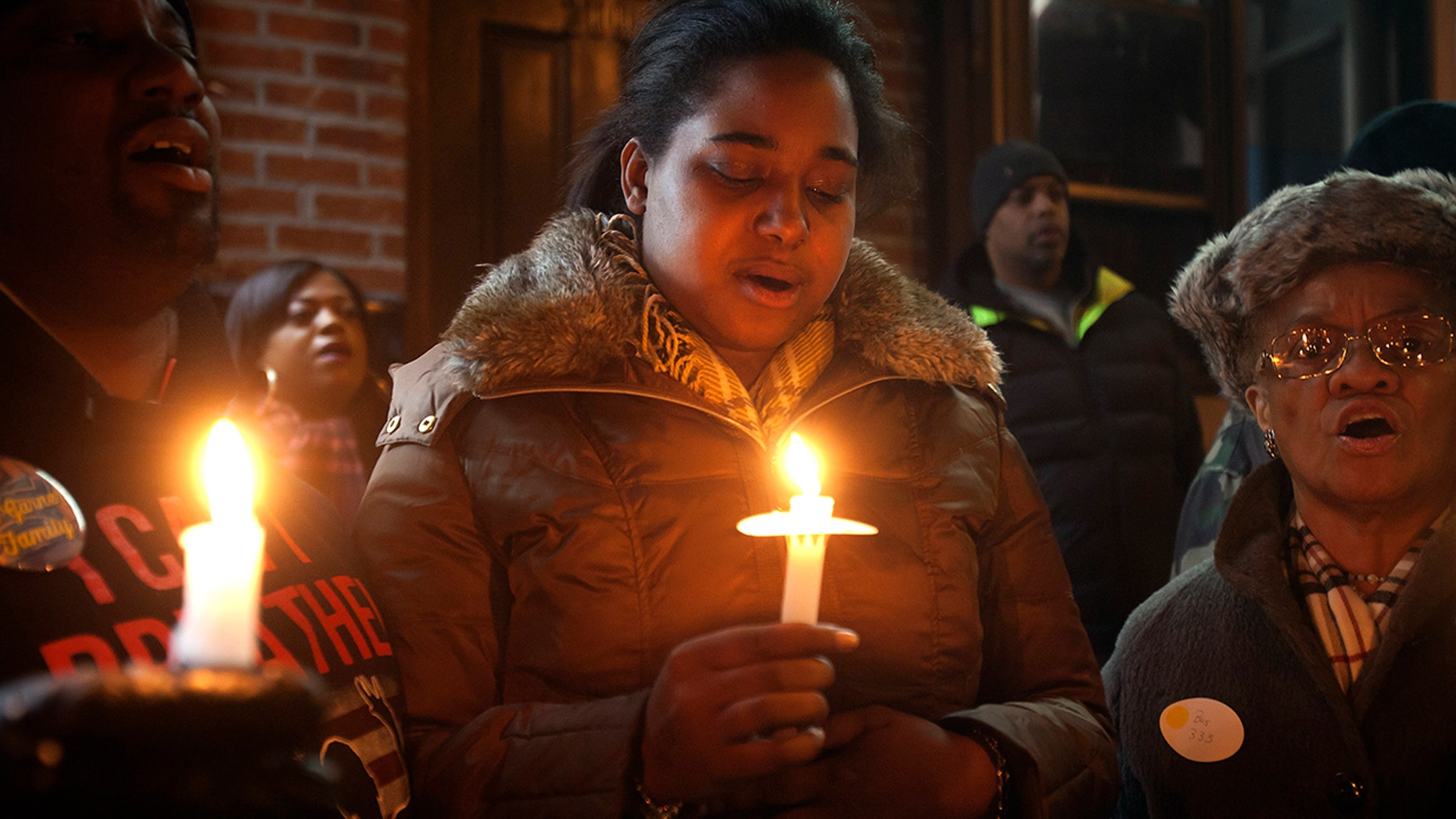 Erica Garner — whose father Eric Garner became a symbol of police brutality when he died after being placed in a chokehold — was in a coma Sunday night after suffering a heart attack, family members said.