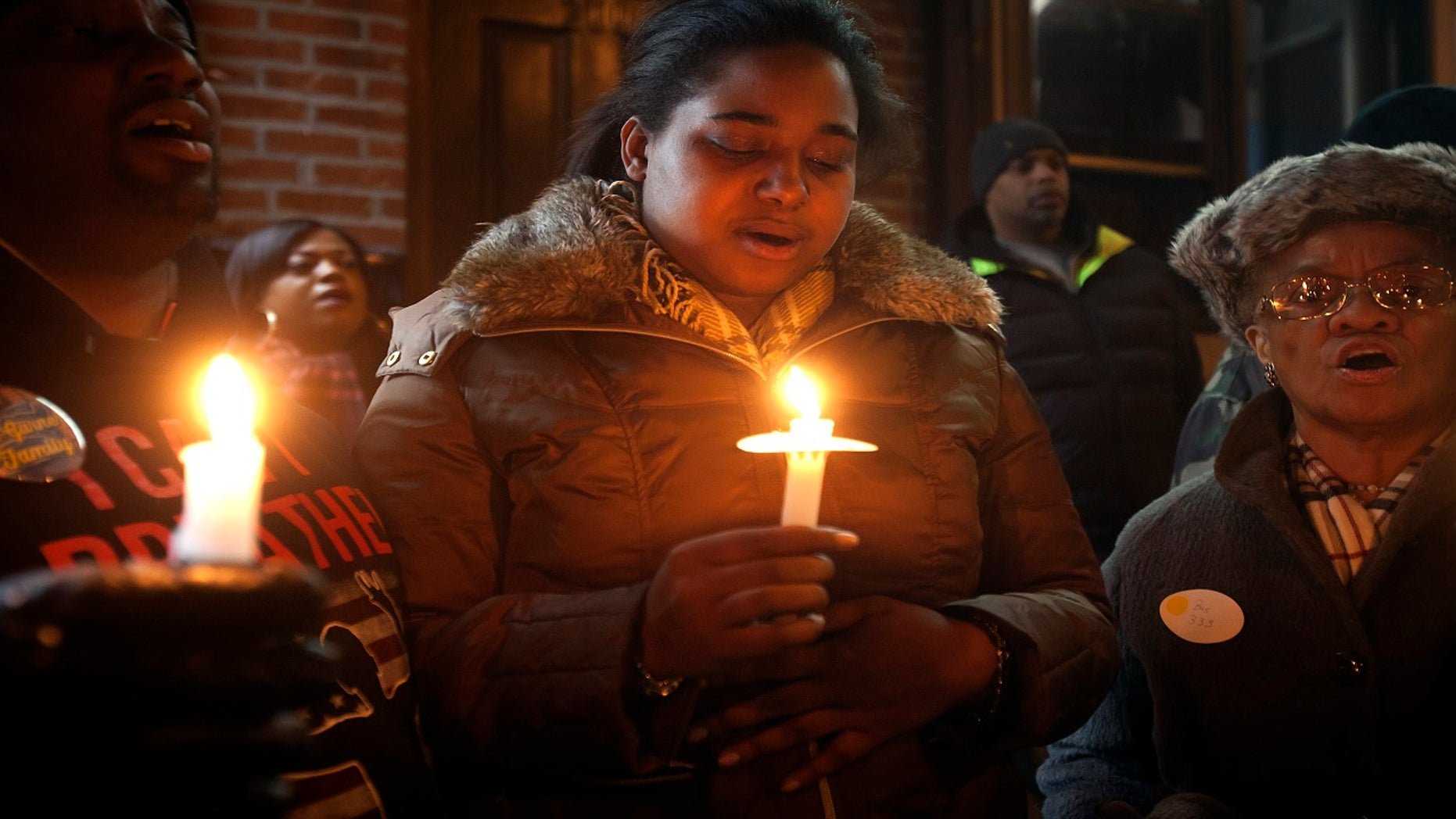 Erica Garner, pictured here in January 2015, has been in a medically induced coma since Saturday, after suffering a heart attack.
