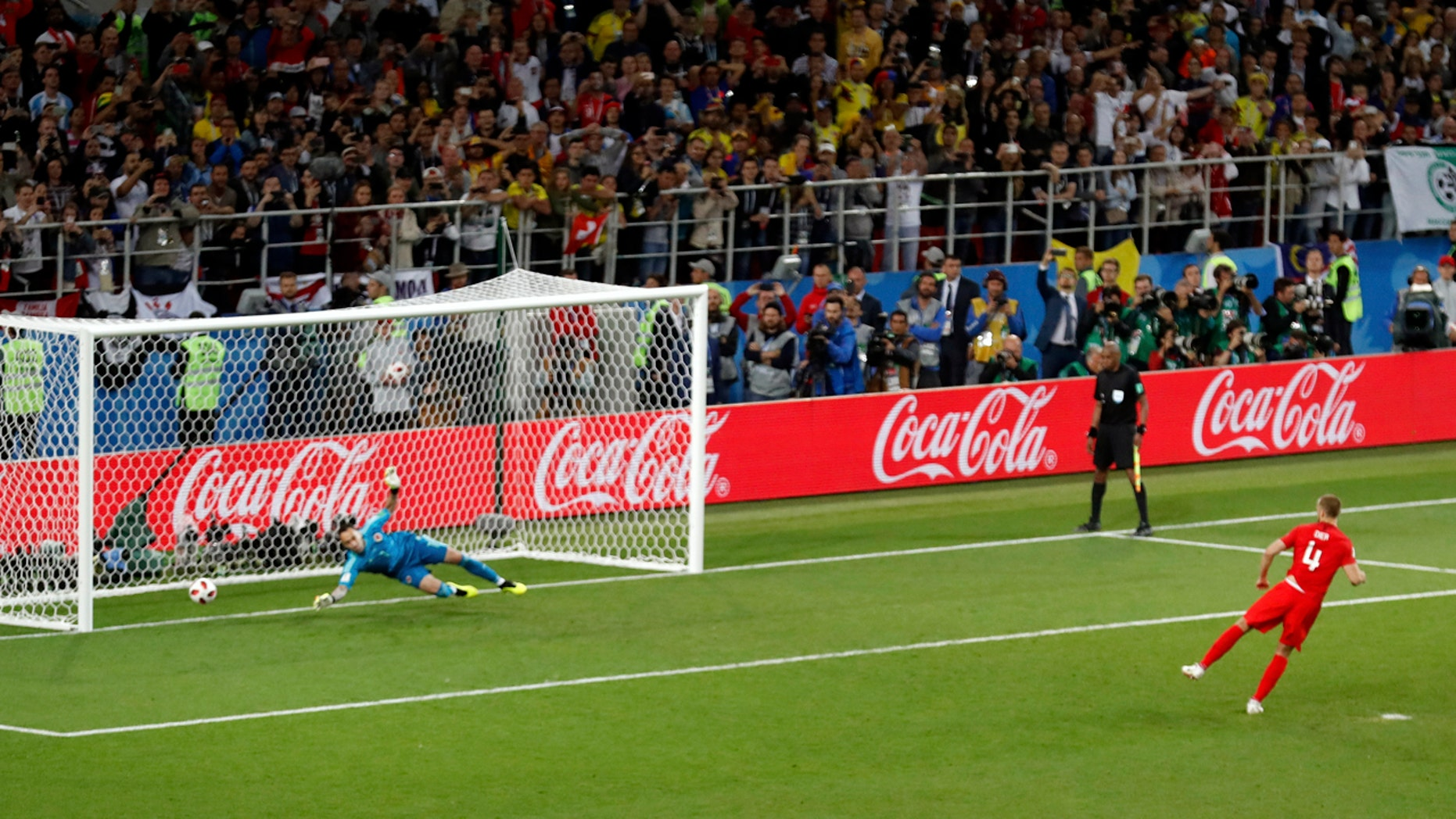 England's Eric Dier scores the winning penalty past Colombia's David Ospina in the World Cup last 16 match at Spartak Stadium, Moscow.