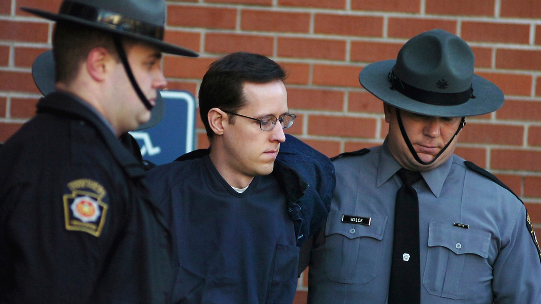 Eric Frein with Pennsylvania state troopers in 2015.