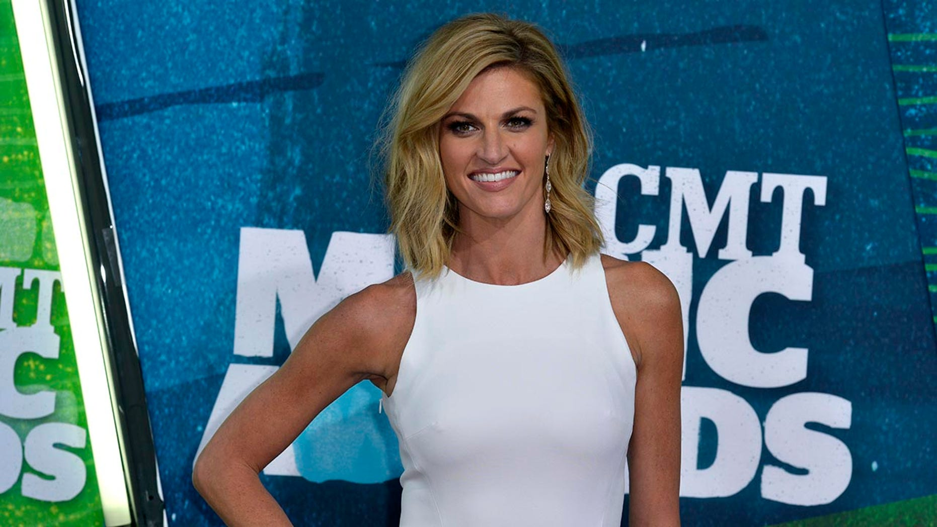 Erin Andrews goes through three outfits in one game.