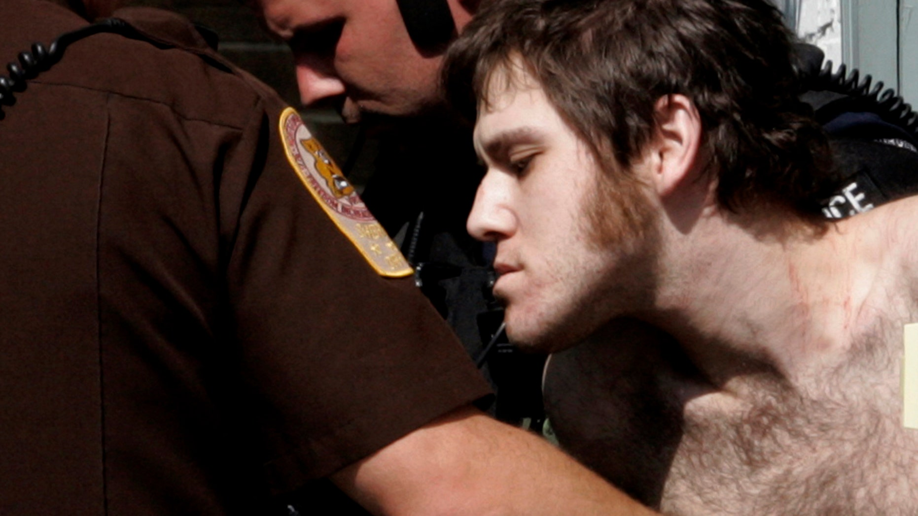FILE: William Morva, is escorted out of the Montgomery County magistrates office after his capture in Christiansburg, Va.