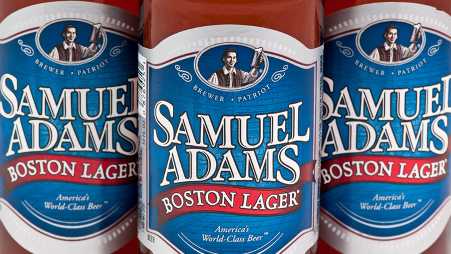 Marietta GA, USA - February 10, 2012: Close up of Samual Adams Boston Lager, 12 fl oz bottles. Samuel Adams is an American Craft Brewer defined as Small, Independent, and Traditional. Their Boston Lager is an excellent example of the fundamentals of a beer offering a full, rich flavor resulting from hand selected ingredients and traditional four vessel brewing.