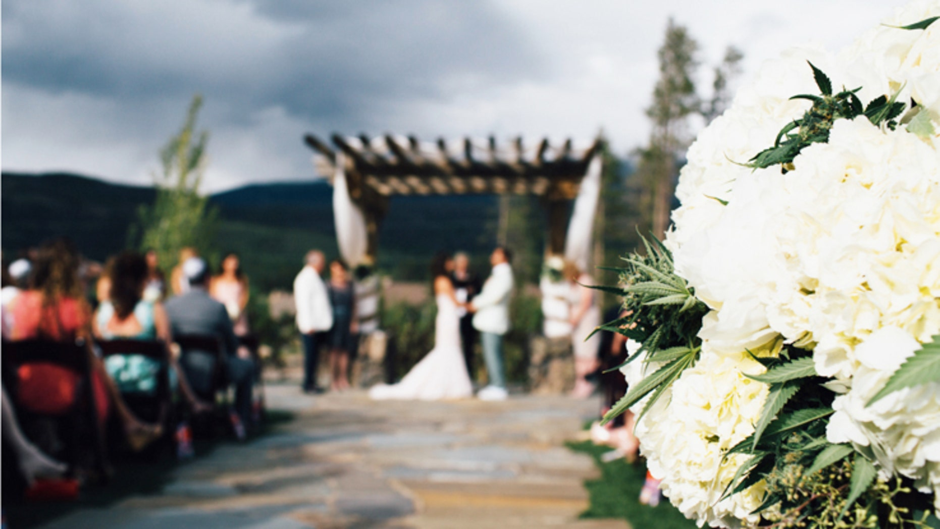 Creative couples can incorporate the cannabis plant into wedding day floral decor.