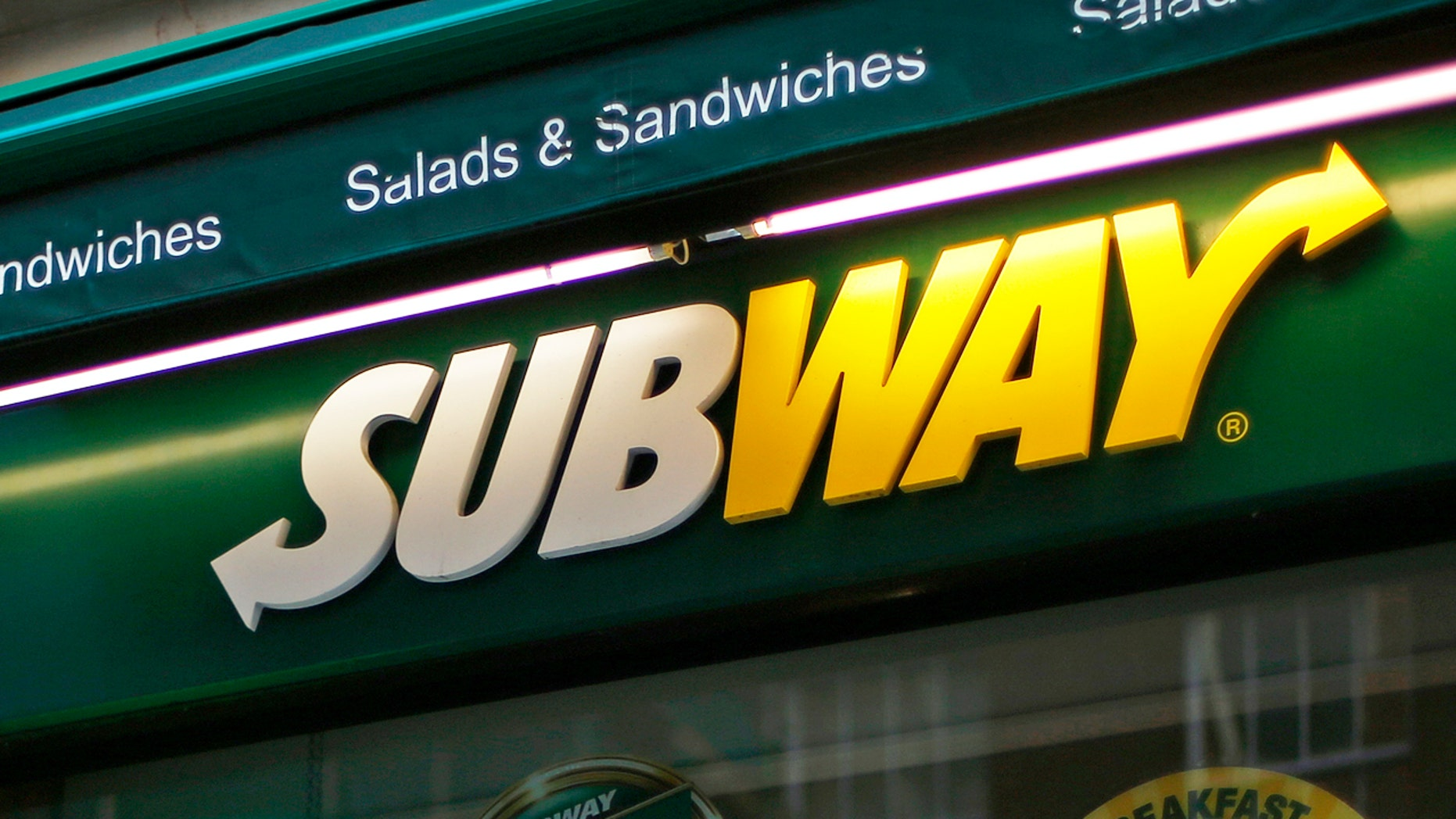 A man walks past a Subway sandwich store in central London January 22, 2014. Subway, one of the largest fast-food chains in the world, plans to open over 1,200 new stores in the UK and Ireland by 2020, creating another 13,000 jobs, it said on Wednesday.