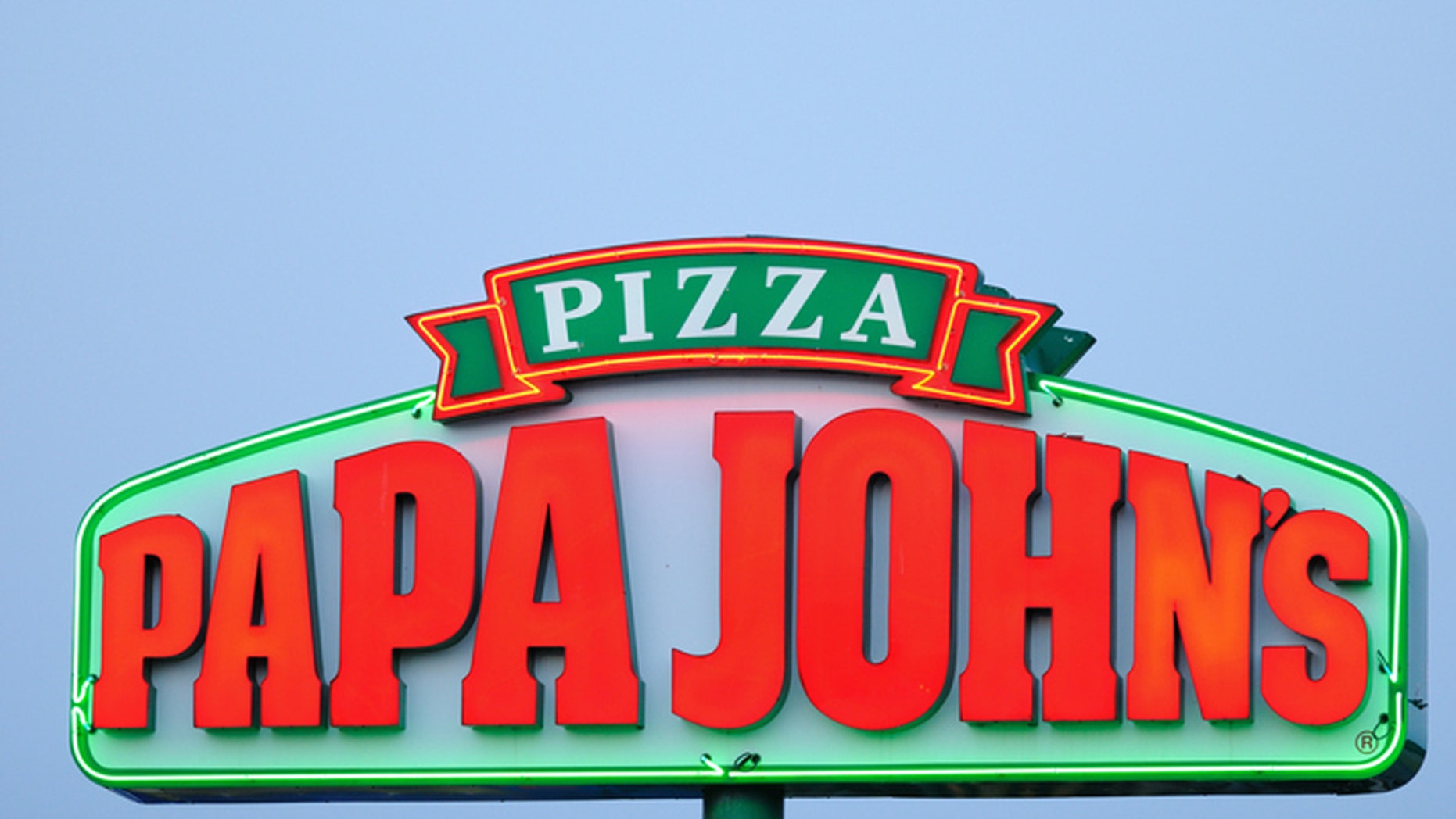 Huntsville, Alabama, USA - June 14, 2011: Close up of illuminated neon Papa Johns Pizza Sign at sunset with copy space above. Sign located on University Drive in Huntsville, Alabama.  Horizontal composition.