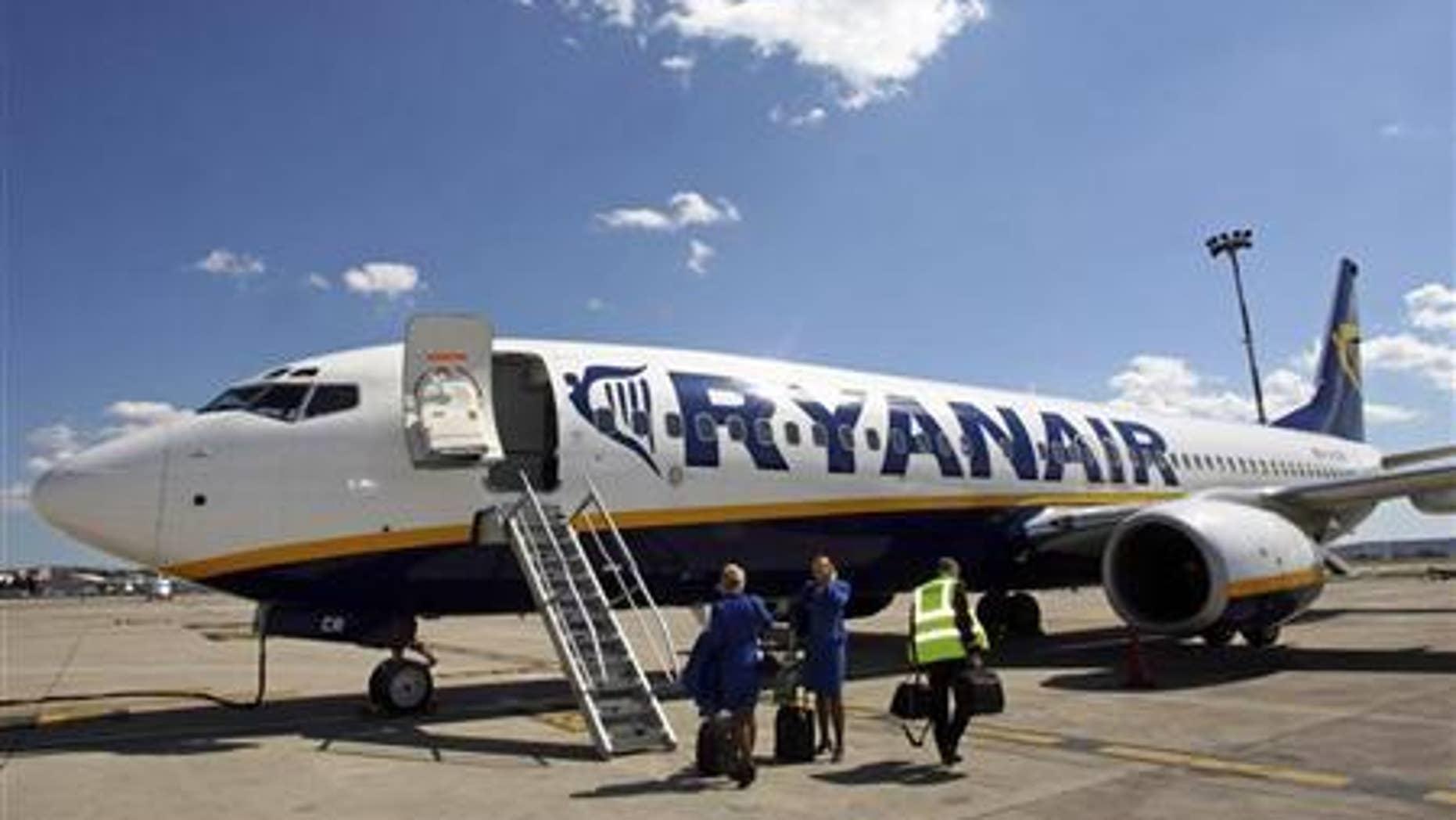 Ryanair crew board an aircraft in France.