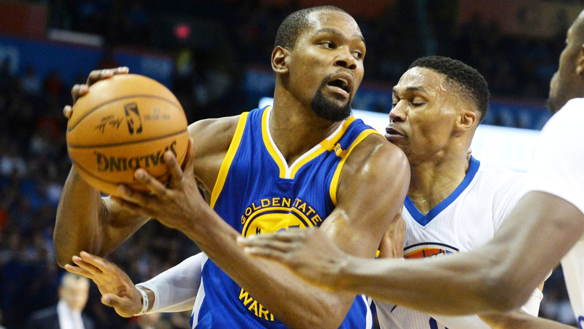 Basketball player Kevin Durant, formally with The Oklahoma City Thunder, now plays for the Golden State Warriors.