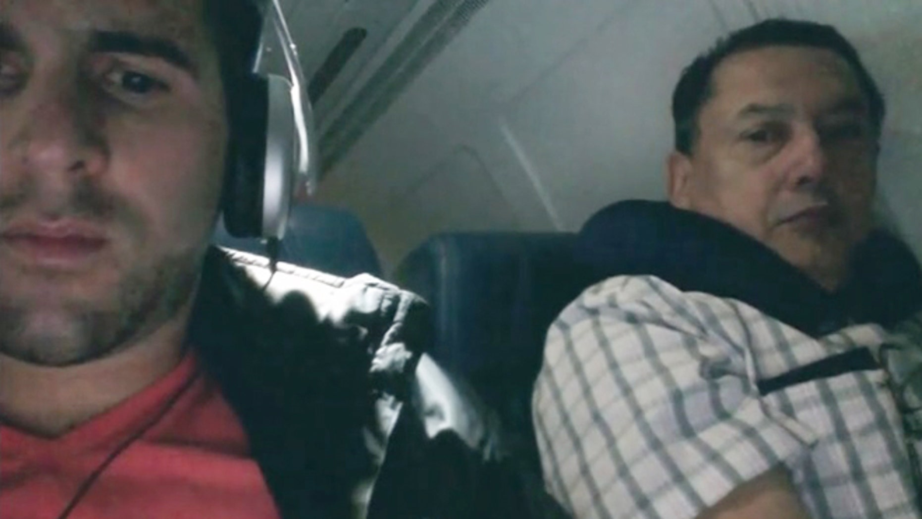 Busted. Clever flyer finds a way to catch a snooping seatmate.