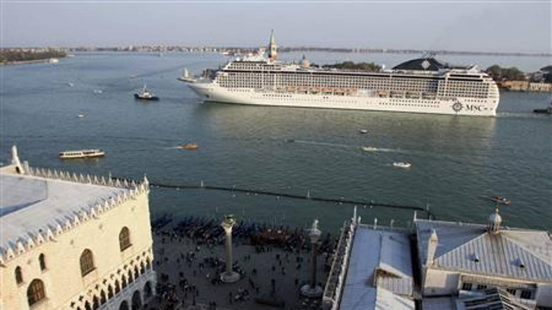 A cruise ship sails in the Venice lagoon close to Doge.