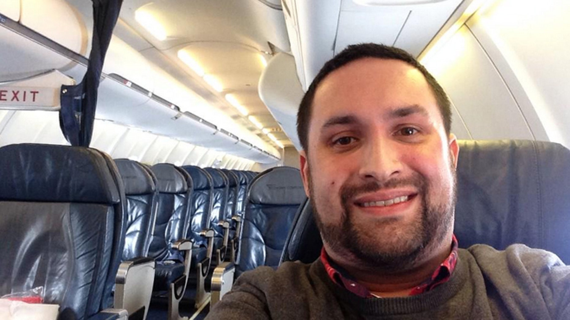 Flying solo: Chris O'Leary snaps a selfie on board his empty flight.