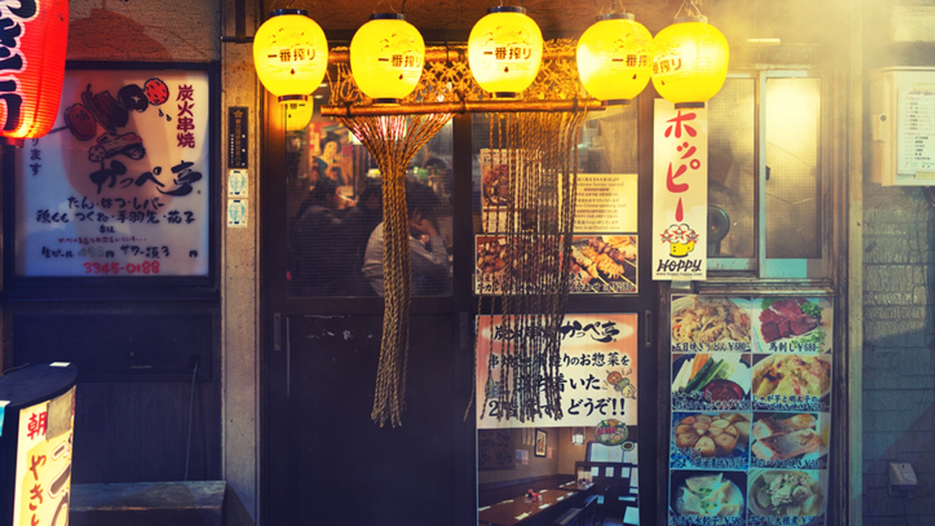 Tokyo, Japan - February 10, 2016: People are having dinner at a Japanese resturant (izakaya)