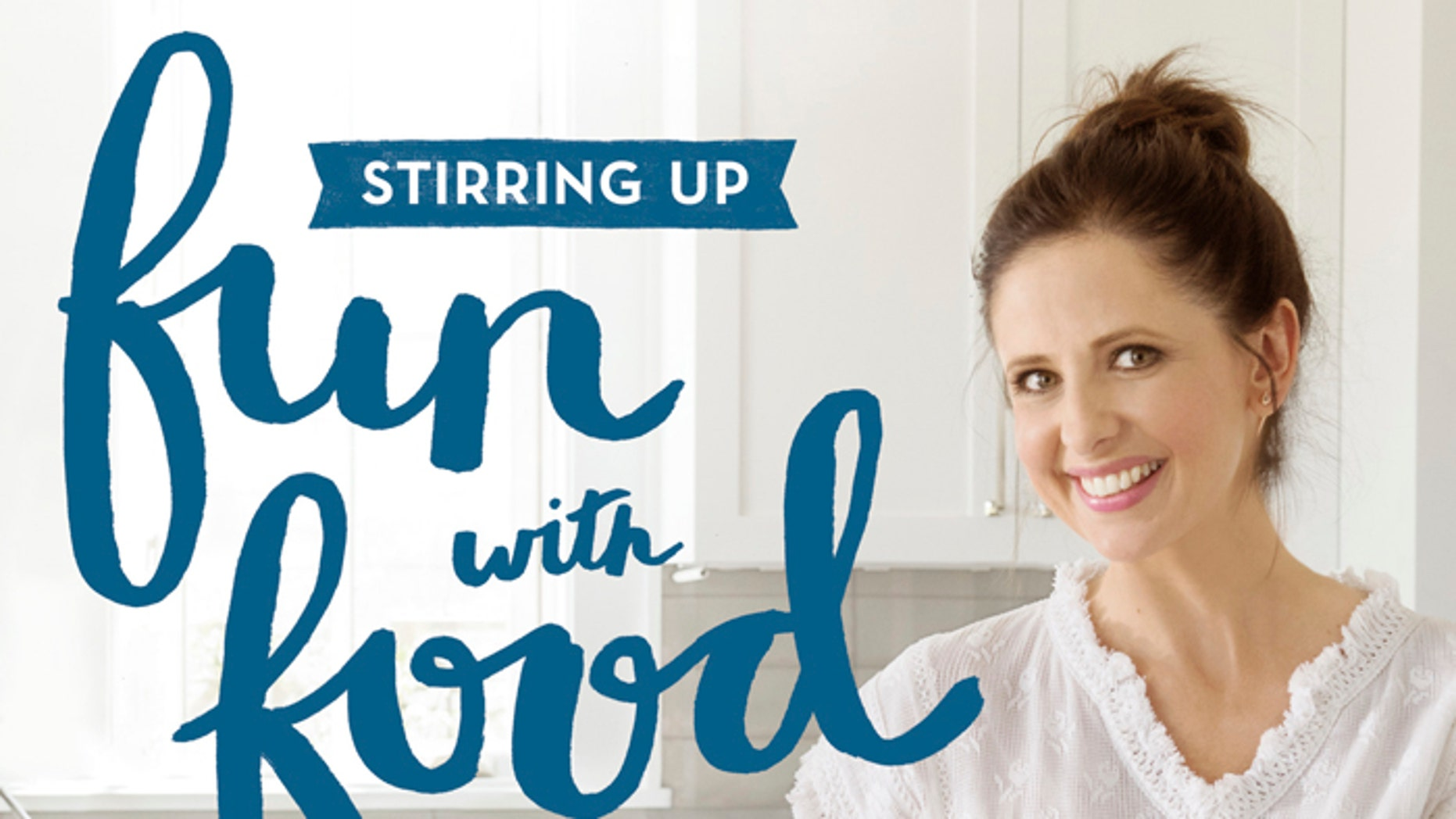 "This cover image released by Grand Central Life & Style shows ""Stirring Up Fun with Food: Over 115 Simple, Delicious Ways to Be Creative in the Kitchen,"" by Sarah Michelle Gellar and Gia Russo."
