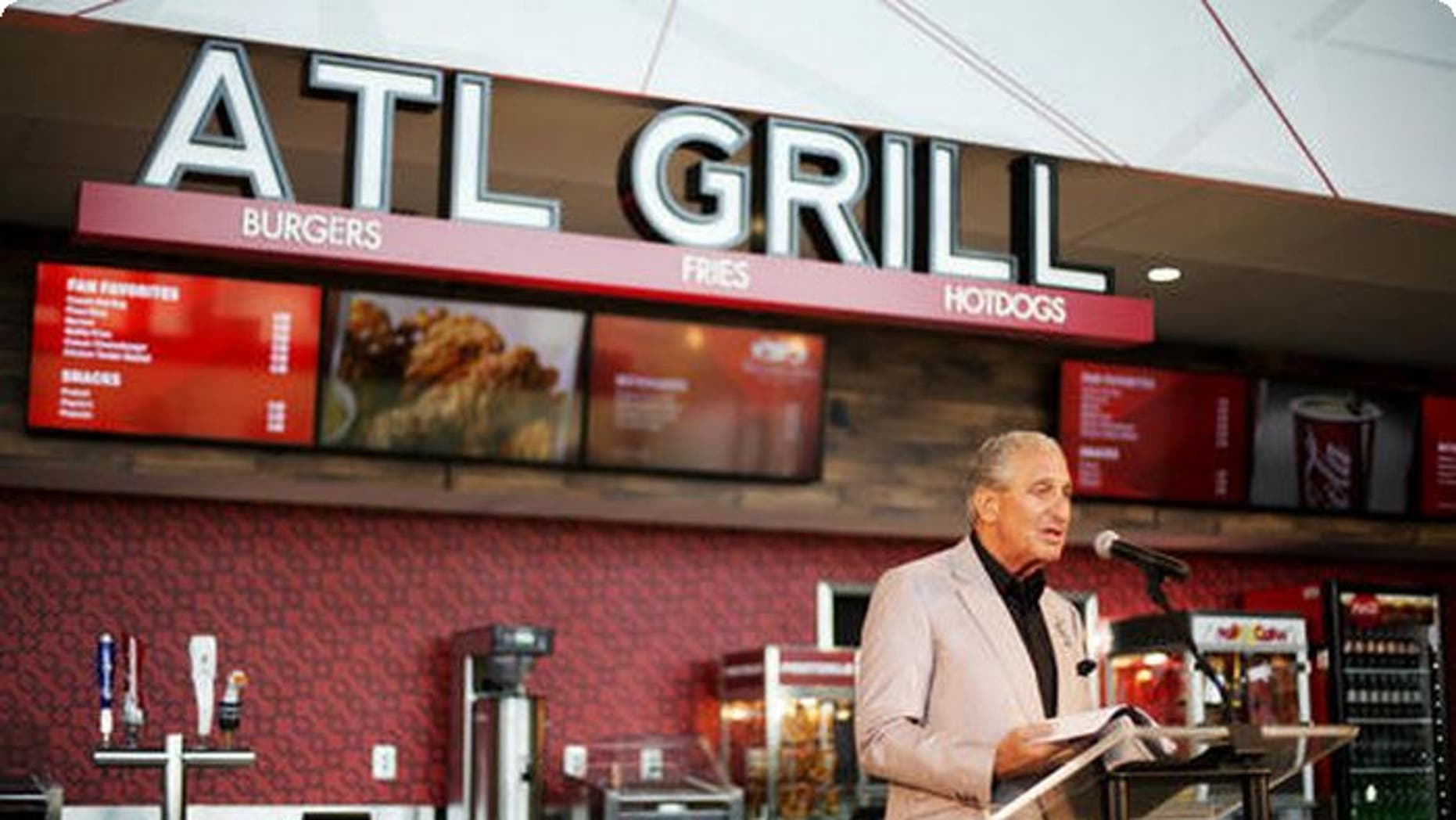 Atlanta Falcons owner Arthur Blank unveils the team's new food and beverage plan at Mercedes-Benz which includes $2 hot dogs and soft drinks, a sharp decrease from current prices at the Georgia Dome.