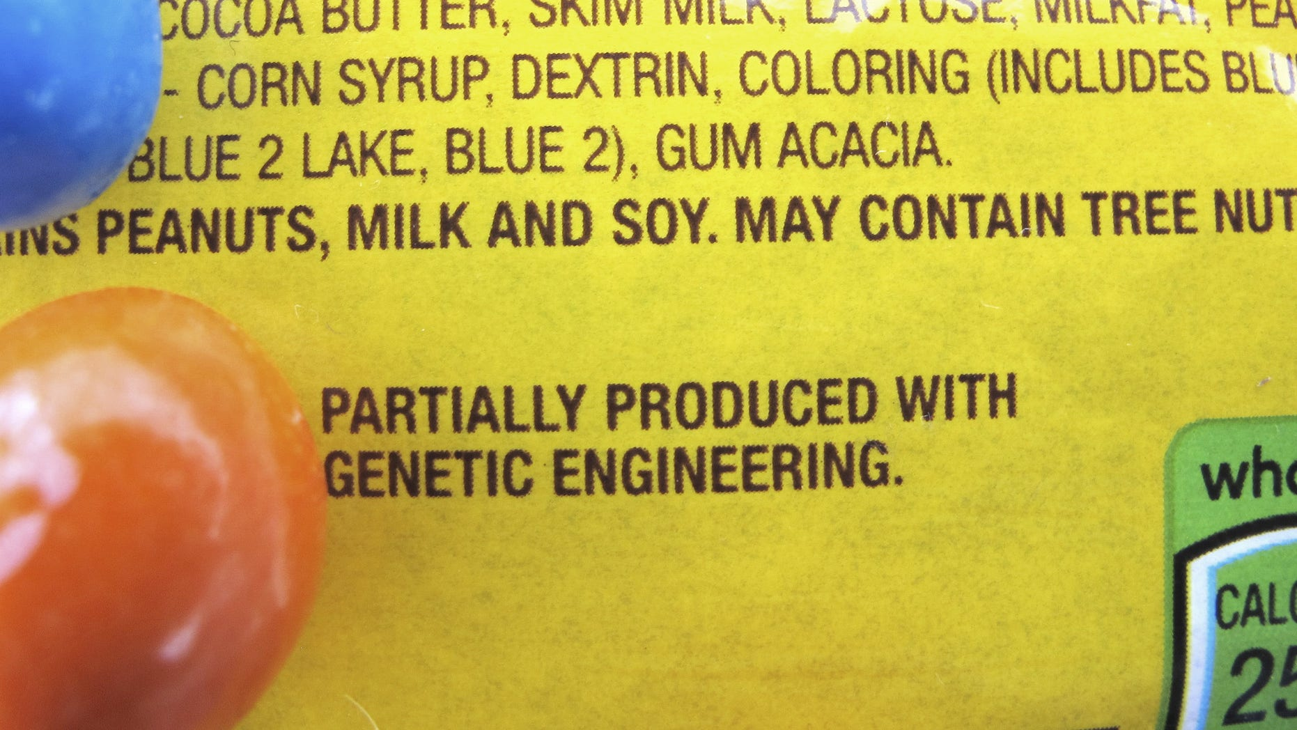 """A new disclosure statement is displayed on a package of Peanut M&Ms candy in Montpelier, Vt., saying they are """"Partially produced with genetic engineering."""" On July 1, Vermont became the first state to require the labeling of foods made with genetically modified ingredients."""