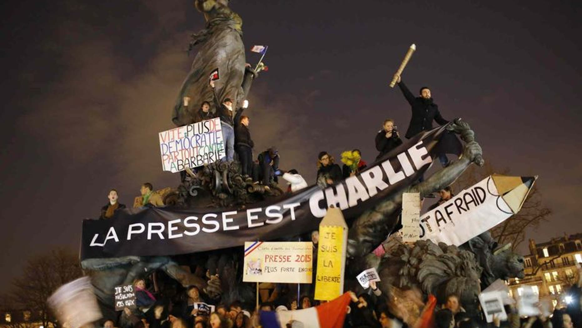 Hundreds of thousands of people marched through Paris on Sunday in a massive show of unity and defiance in the face of terrorism that killed 17 people in France's bleakest moment in half a century