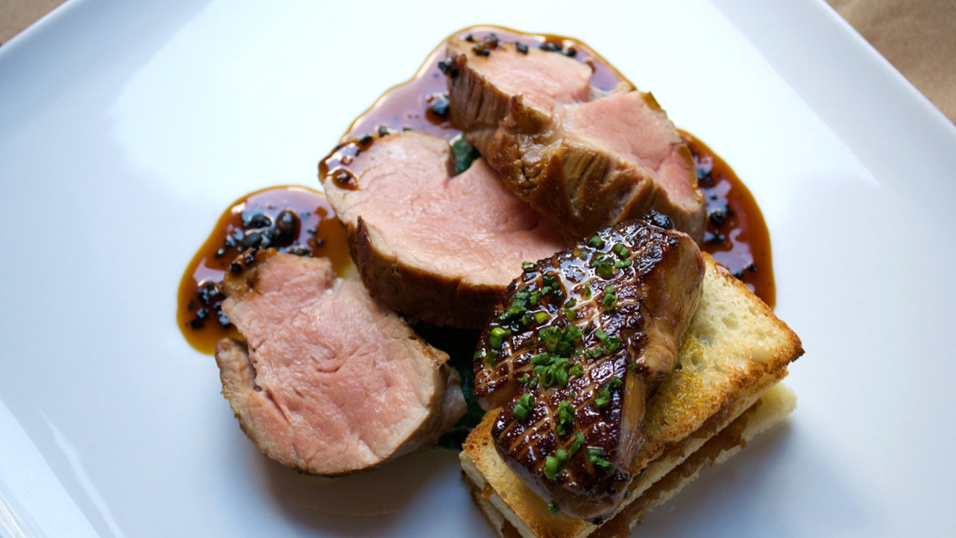 The veal tenderloin served with foie gras, a caramelized onion tartine, and black truffle jus at Altamarea's Vaucluse.