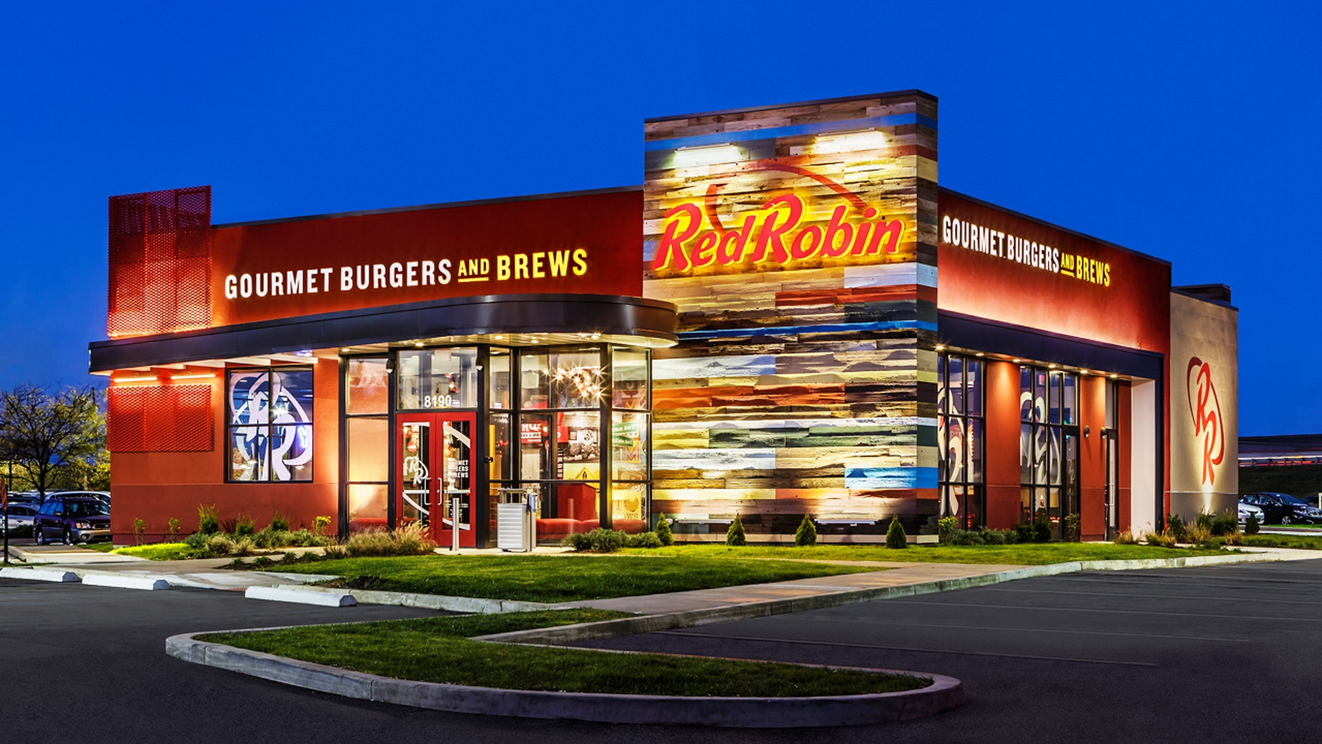 Red Robin CEO Denny Marie Post got inked after employees improved their service grades.